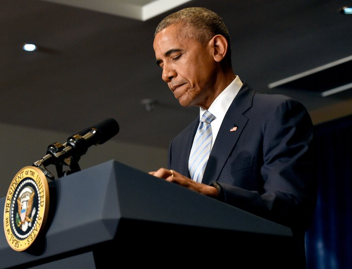 President Barack Obama pauses as he makes a statement on the fatal police shootings of two black men in Louisiana and Minnesota after arriving in Warsaw, Poland, Friday, July 8, 2016.