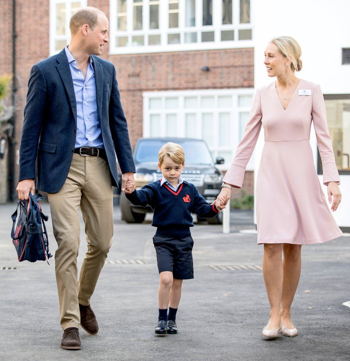 Prince George accompanied by Britain's Prince William, Duke of Cambridge arrives for his first day of school at Thomas's school where he is met by Helen Haslem (R) head of the lower school on September 7, 2017 in southwest London.