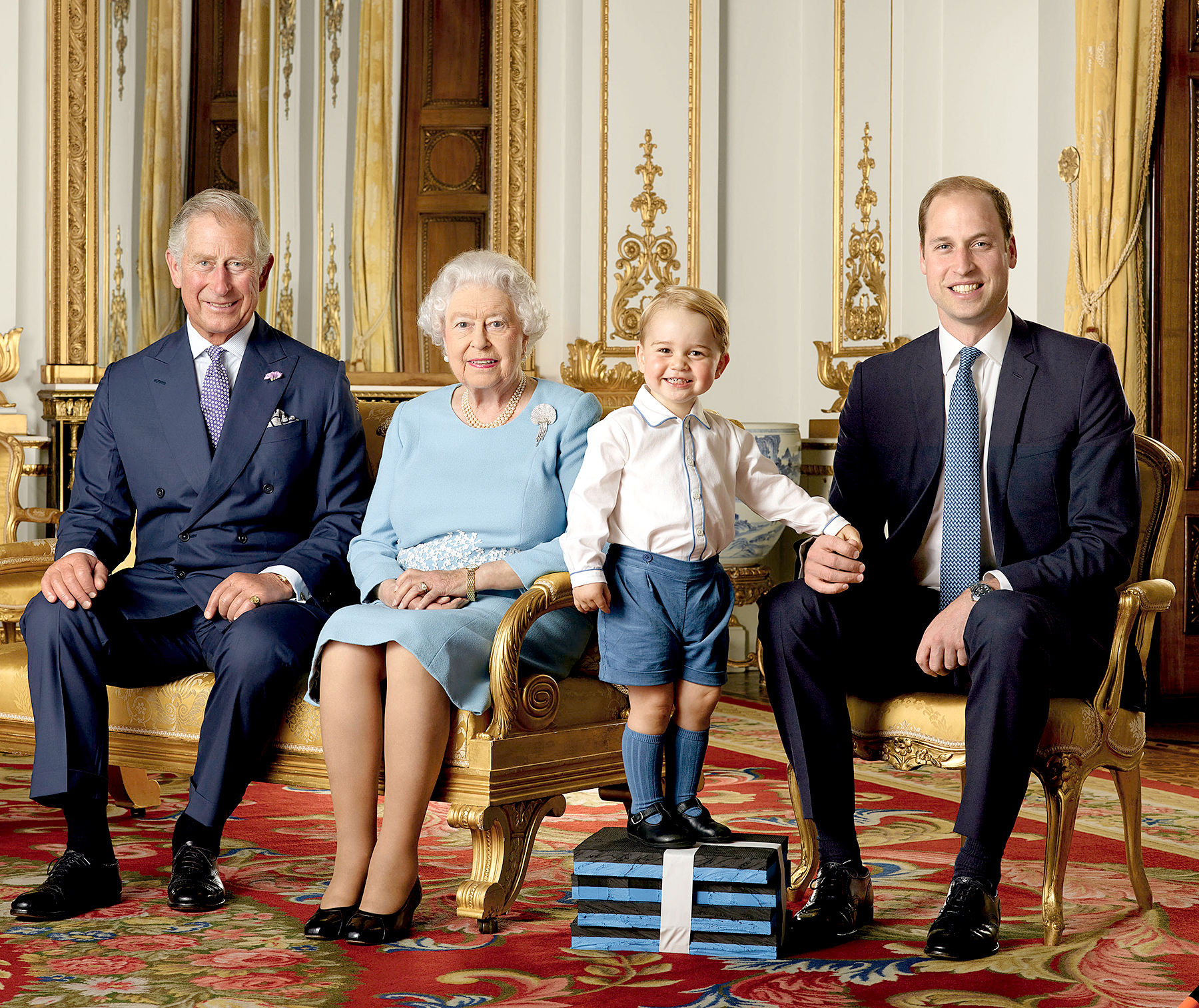 Prince George stands on foam blocks during a Royal Mail photoshoot for a stamp sheet to mark the 90th birthday of Queen Elizabeth II.