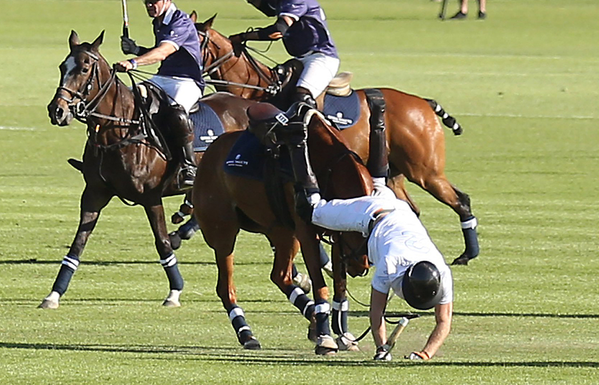 Prince Harry falls off his horse.