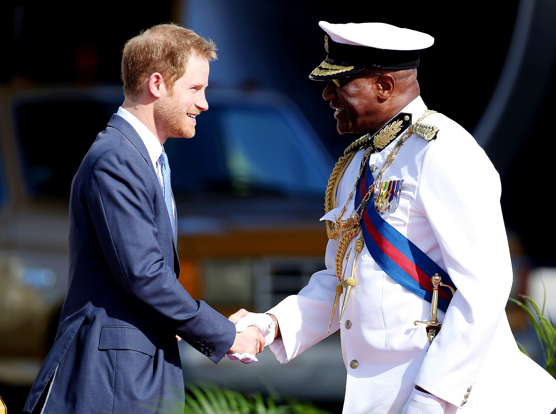Prince Harry is greeted by the Governor General His Excellency Sir Rodney Williams on his arrival at V.C. Bird International Airport in Antigua at the start of his 15-day tour of the Caribbean.