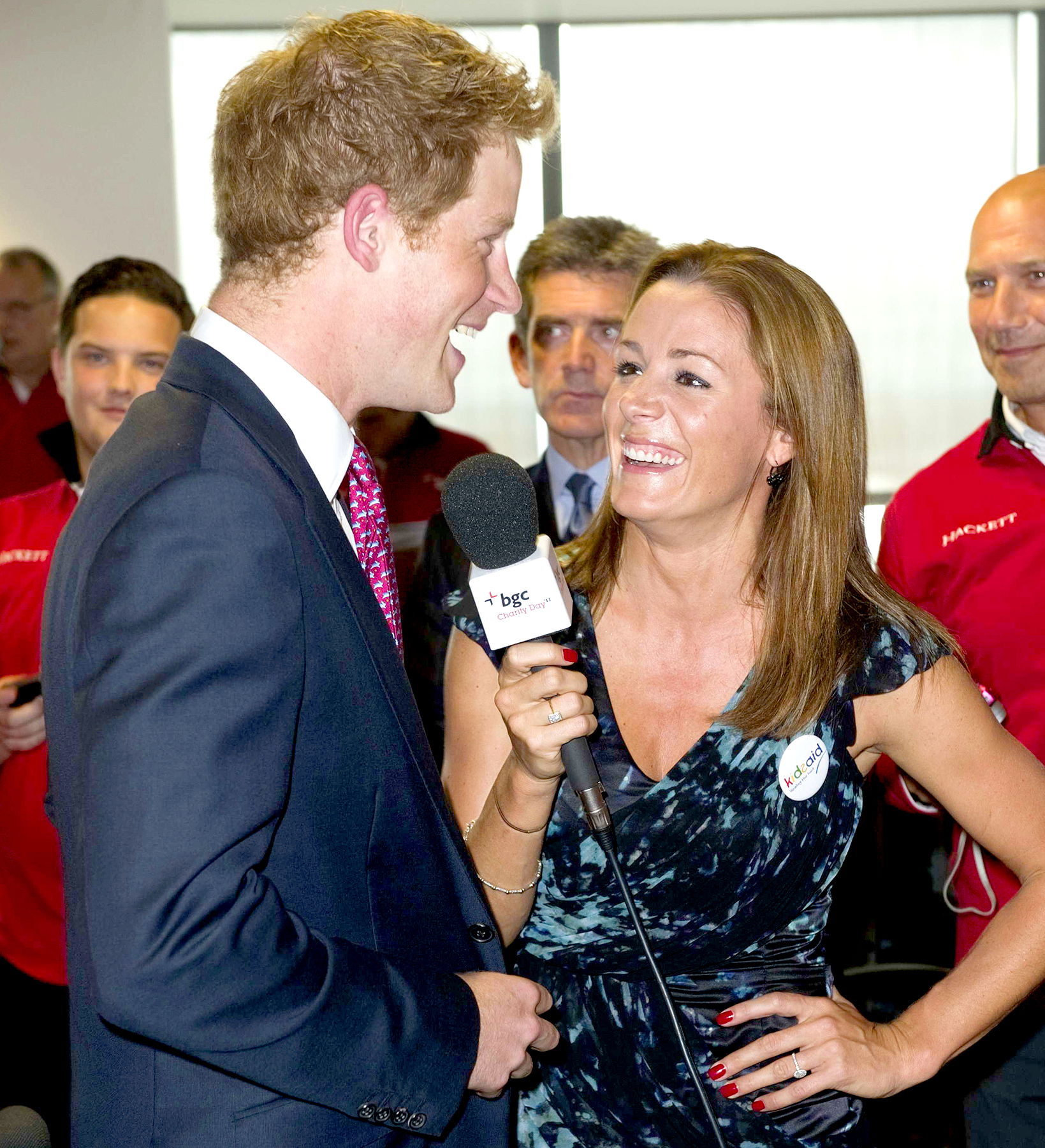 Britain's Prince Harry talks to British TV and radio presenter Natalie Pinkham on the trading floor as he attends BGC Partners' Charity Day in London, on September 12, 2011.