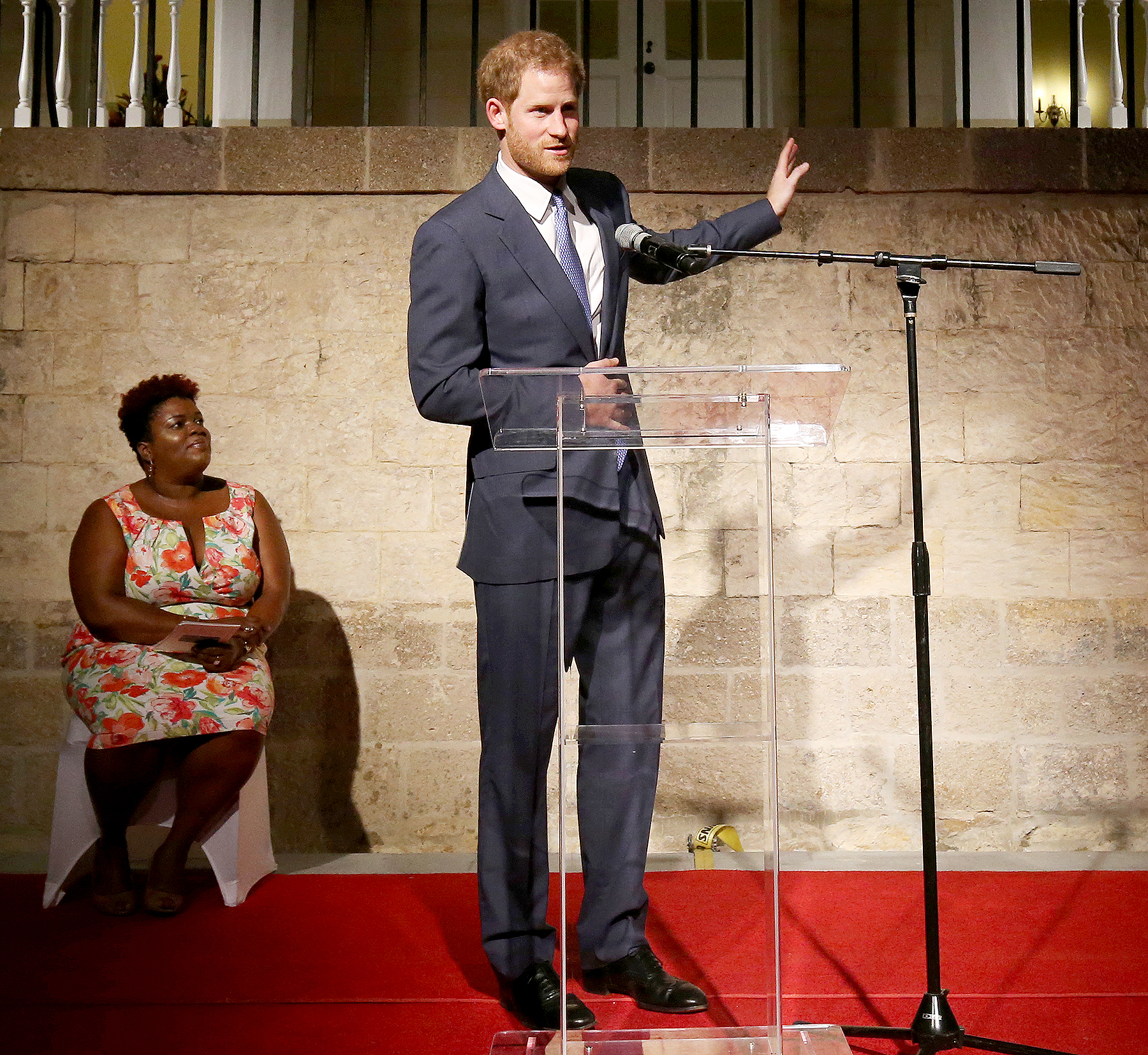 Prince Harry delivers a speech during a welcome reception hosted by the Governor General, Sir Rodney Williams, at the newly renovated Clarence House on the first day of an official visit, on Nov. 20, 2016, in Antigua.