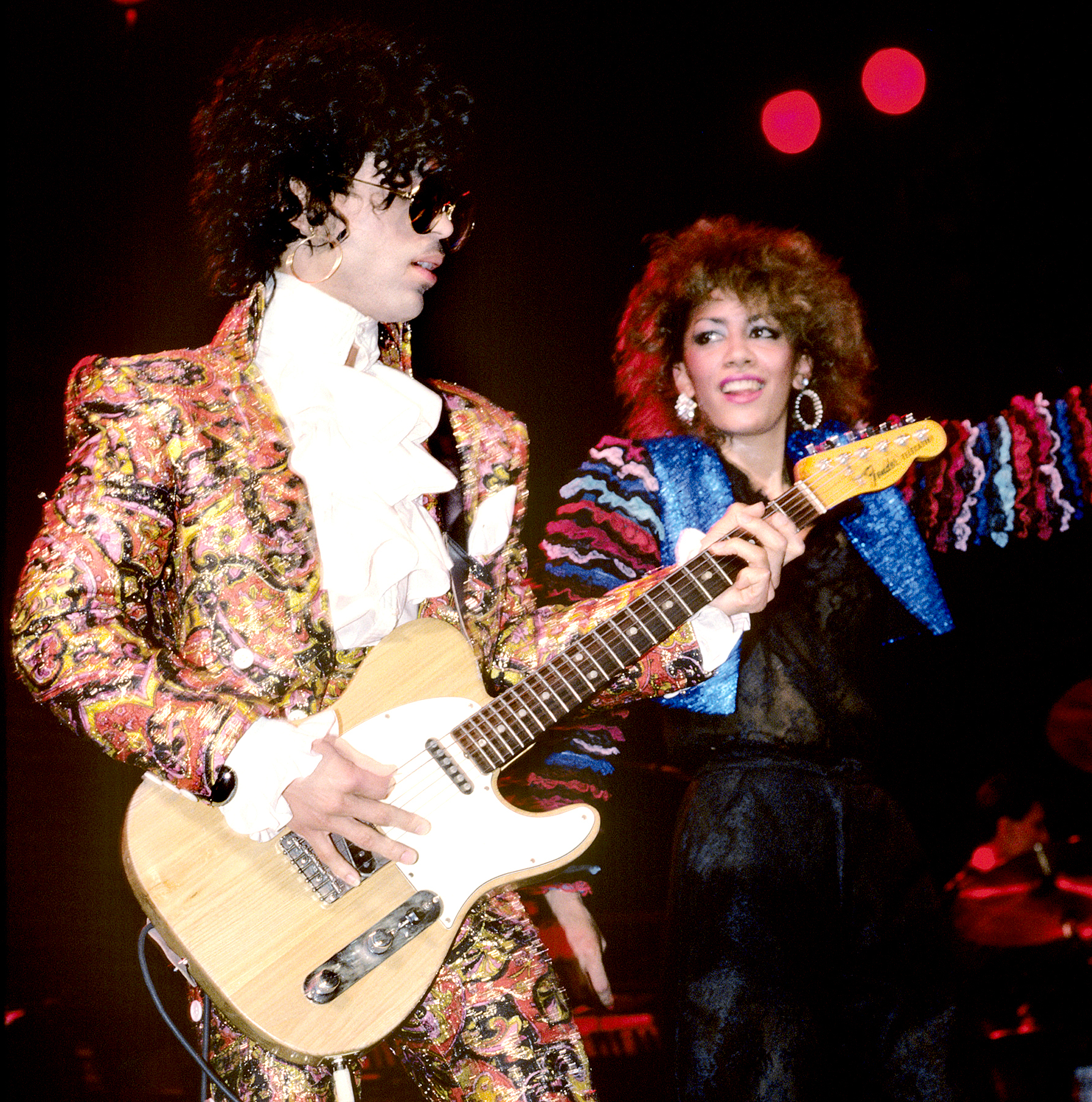 Prince and Sheila E performing on stage on the Purple Rain tour in 1984.