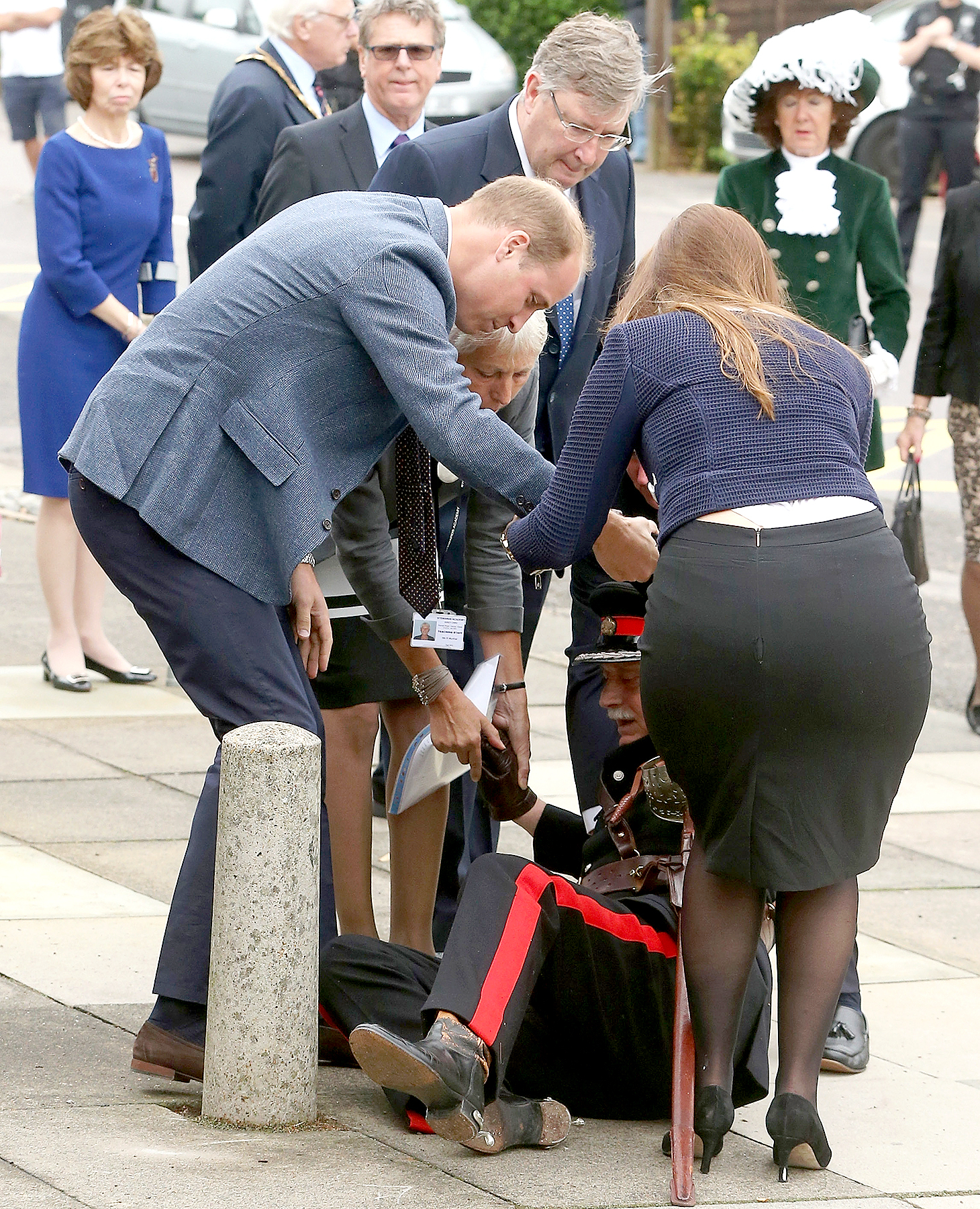 Prince William, Duke of Cambridge rushes to help Vice Lord Lieutenant of Essex Jonathon Douglas-Hughes who fell backwards over a bollard as they arrive at Steward's Academy on September 16, 2016 in Harlow, England.