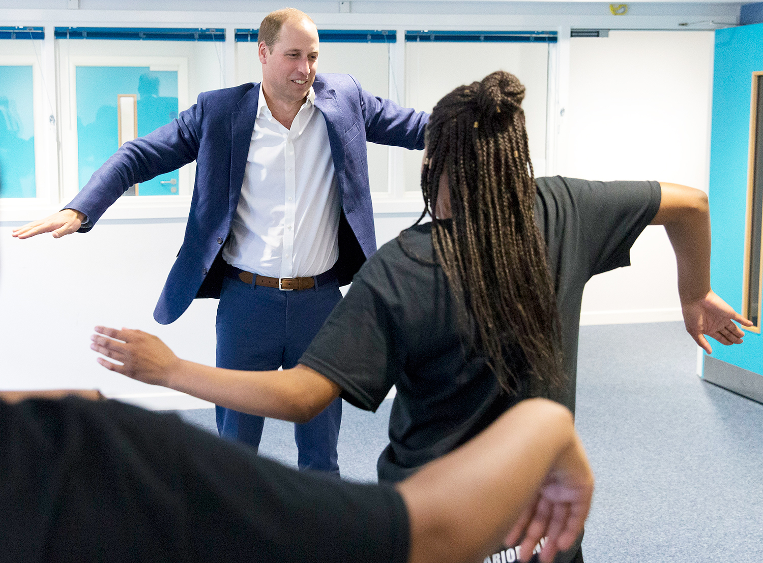 Prince William learns a dance move with Scariofunk dance collective during a visit to Caius House Youth Centre in London on September 14, 2016.