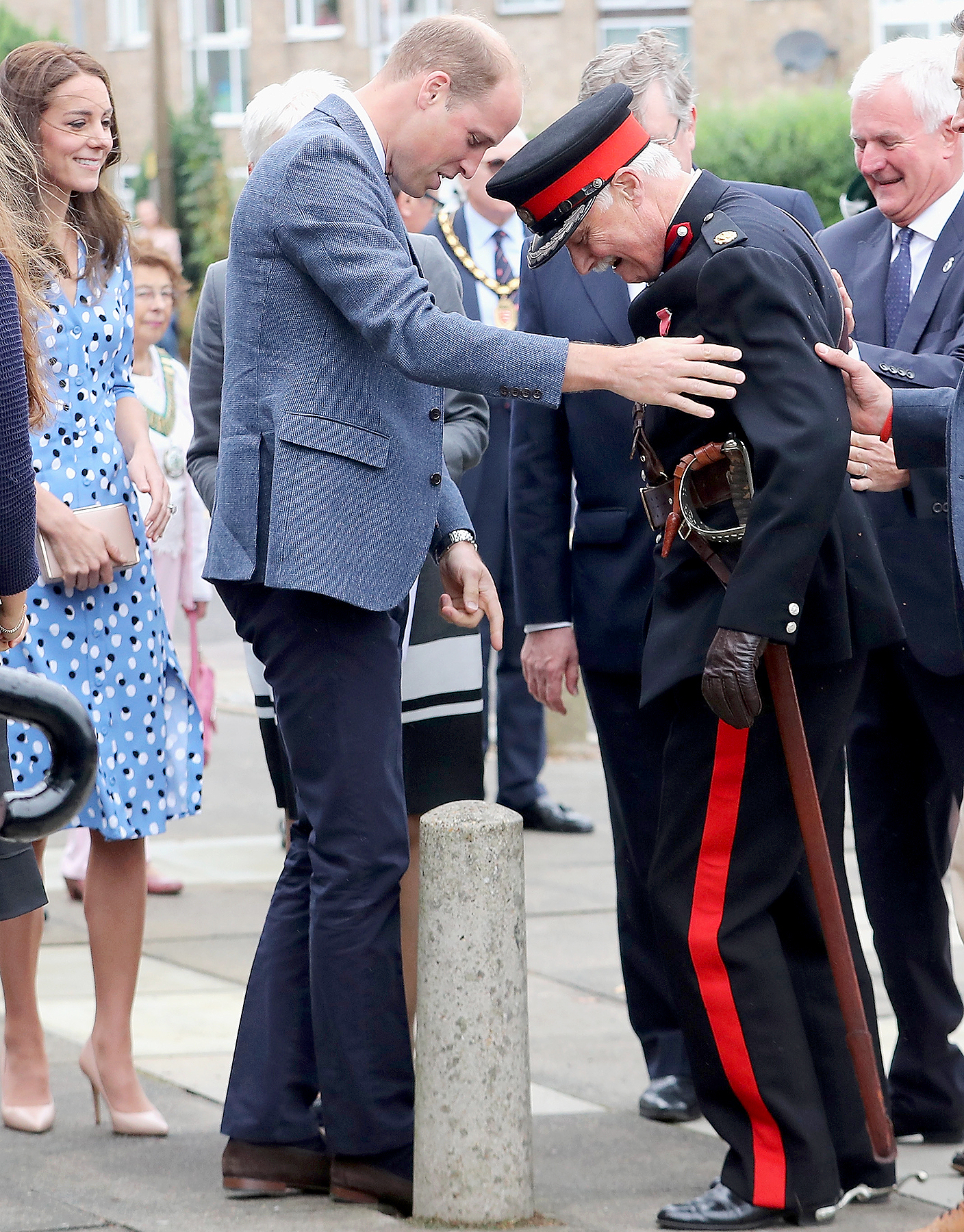Catherine, Duchess of Cambridge looks on as Prince William, Duke of Cambridge rushes to helpVice Lord Lieutenant of Essex Jonathon Douglas-Hughes who fell backwards over a bollard as they arrive at Steward's Academy on September 16, 2016 in Harlow, England.
