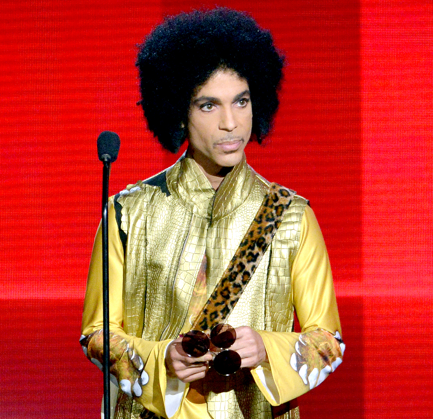 Prince speaks onstage during the 2015 American Music Awards.