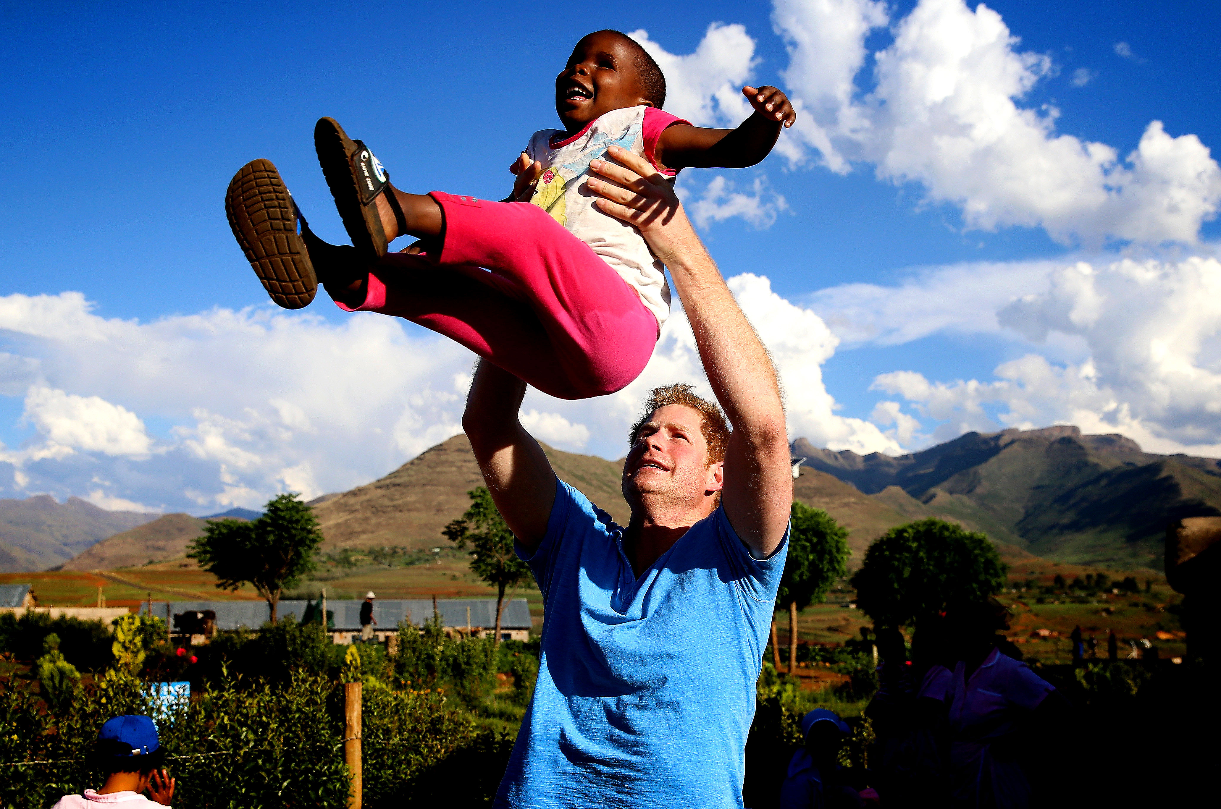 Prince Harry - In connection with his charity Sentebale — which supports Lesotho orphans and vulnerable children, many of whom are affected by the HIV/AIDS epidemic — Prince Harry played with a blind girl during a visit to Phelisanong Children's Home in December 2014.