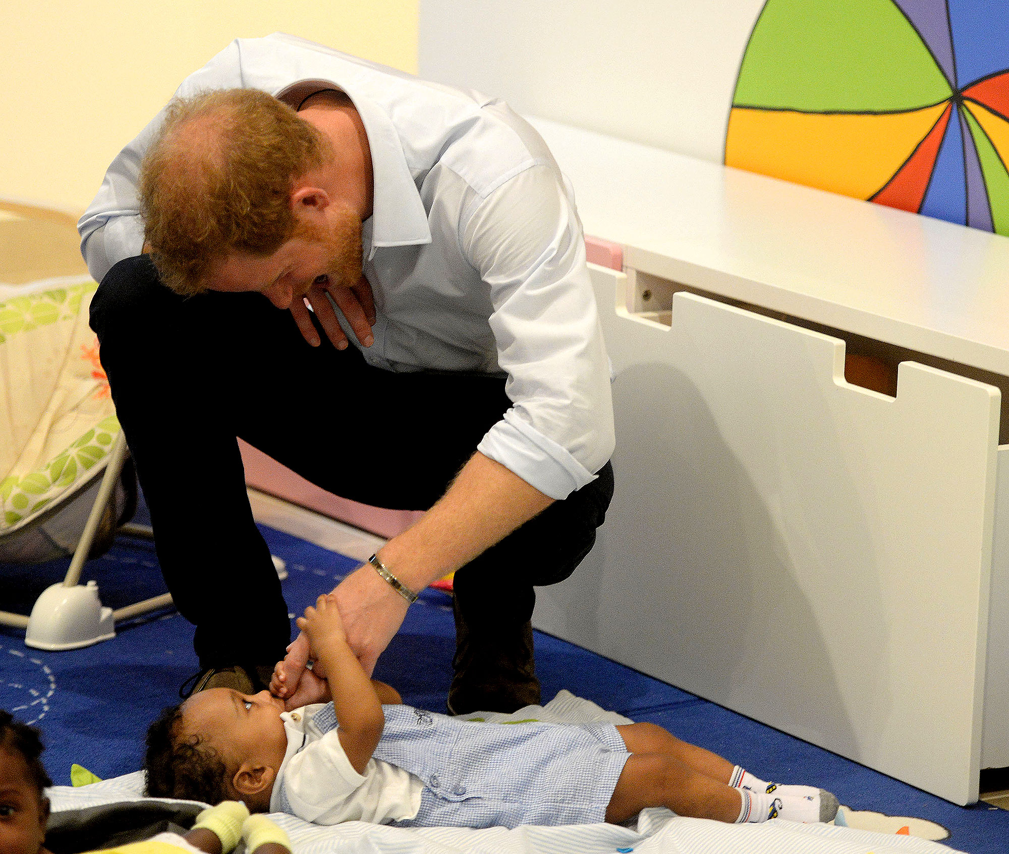 Prince Harry - The former Air Corps soldier befriended a baby at Barbados' Nightingale Children's Home in December 2016.