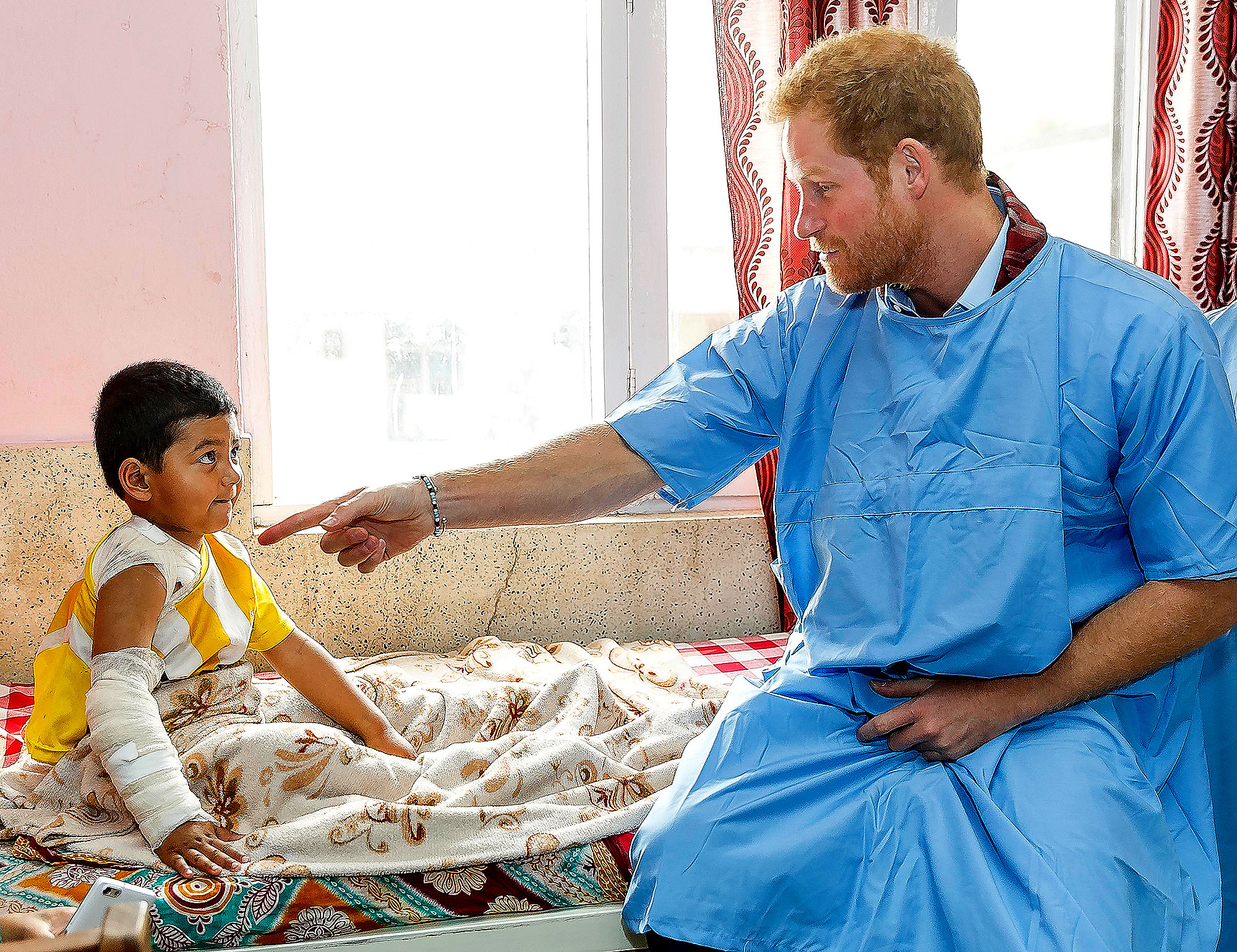 Prince Harry - In March 2016, Prince Harry met with young burn victims in Nepal.