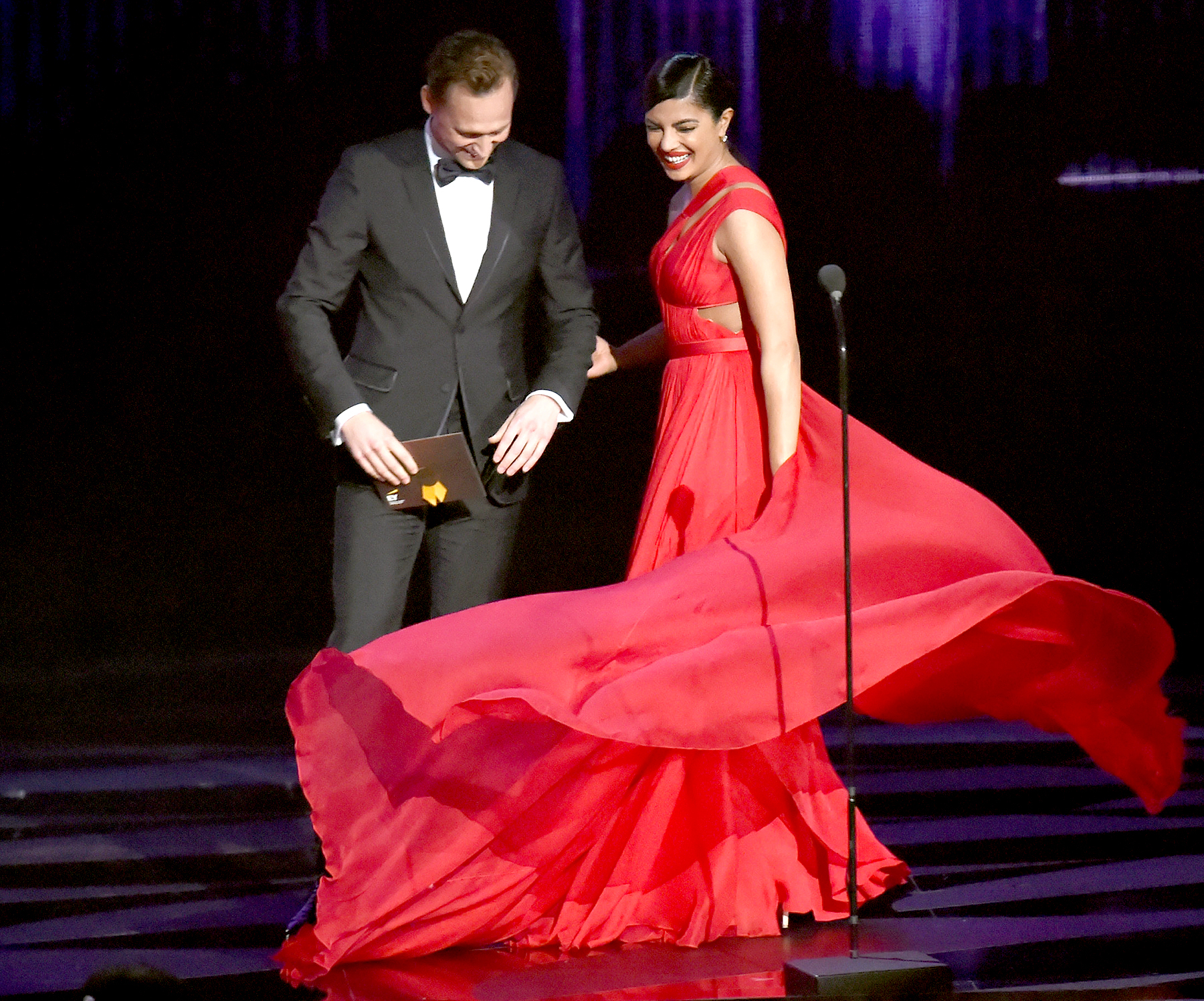 Tom Hiddleston and Priyanka Chopra speak onstage during the 68th Annual Primetime Emmy Awards.