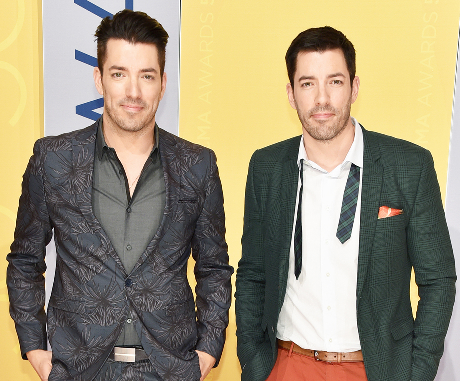 Jonathan Scott and Drew Scott attend the 50th annual CMA Awards at the Bridgestone Arena on November 2, 2016 in Nashville, Tennessee.