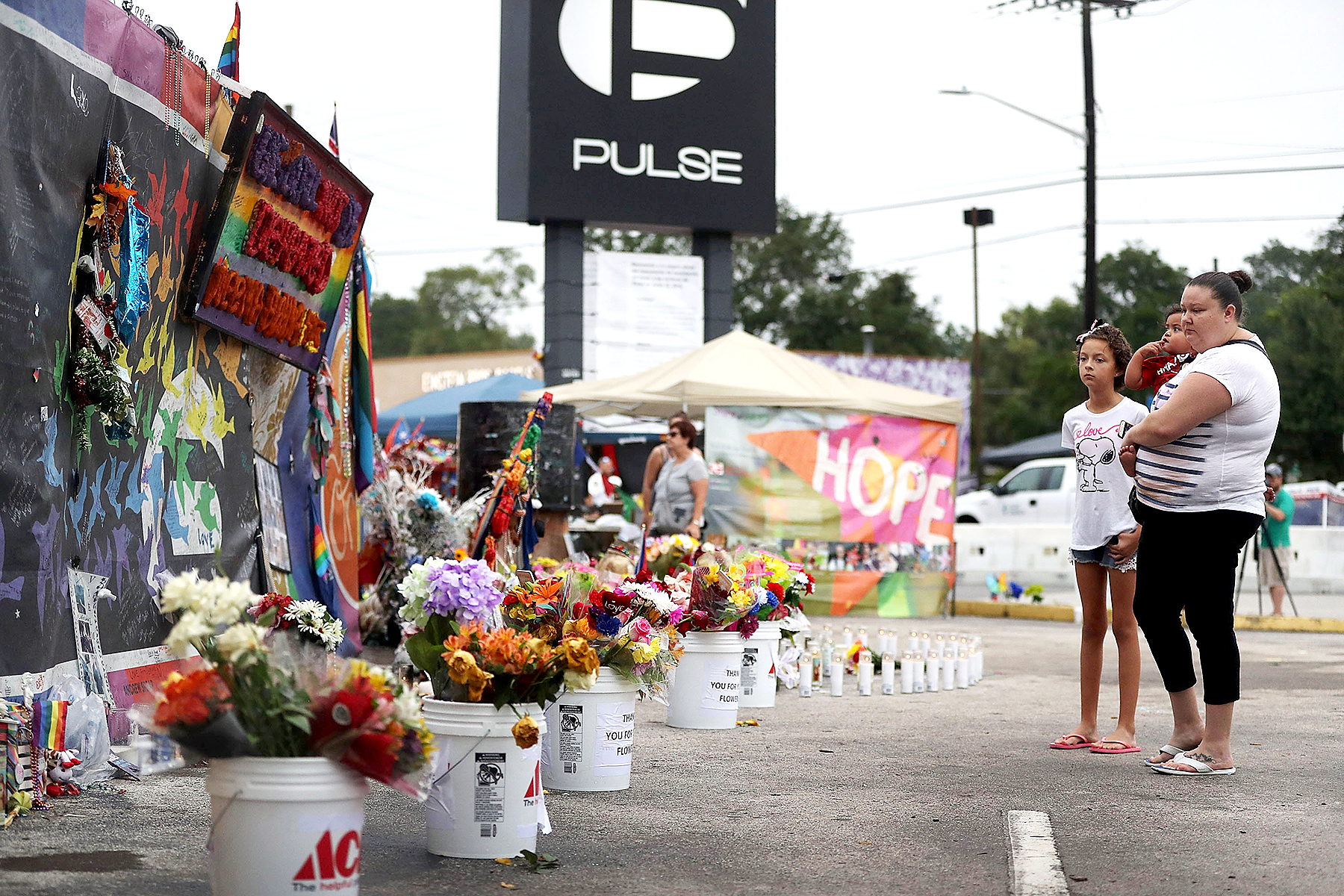 People visit the memorial to the victims of the mass shooting setup around the Pulse gay nightclub one year after the shooting on June 12, 2017 in Orlando, Florida. Omar Mateen killed 49 people at the club a little after 2 a.m. on June 12, 2016.
