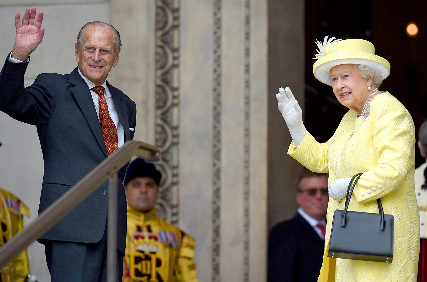 Queen Elizabeth II and Prince Phillip, Duke of Edinburgh, wave before entering the National Service of Thanksgiving as part of the 90th birthday celebrations for the Queen at St Paul's Cathedral on June 10, 2016 in London.