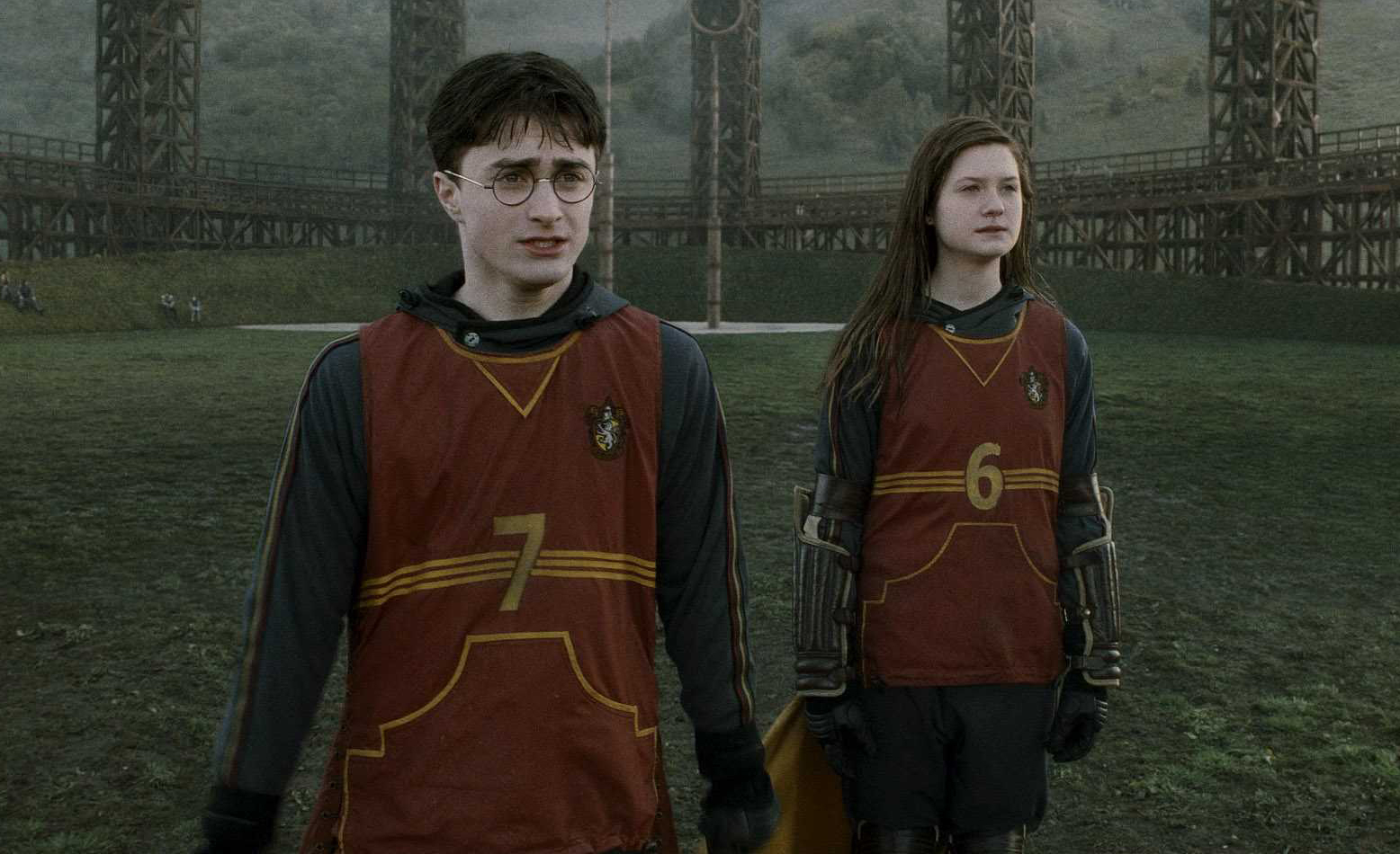 Daniel Radcliffe and Bonnie Wright in Harry Potter.