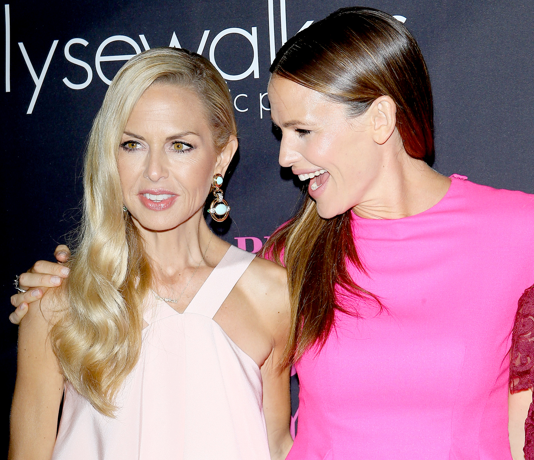 Rachel Zoe and Jennifer Garner arrive at the 10th Annual Pink Party held at Santa Monica Airport on October 18, 2014 in Santa Monica, California.