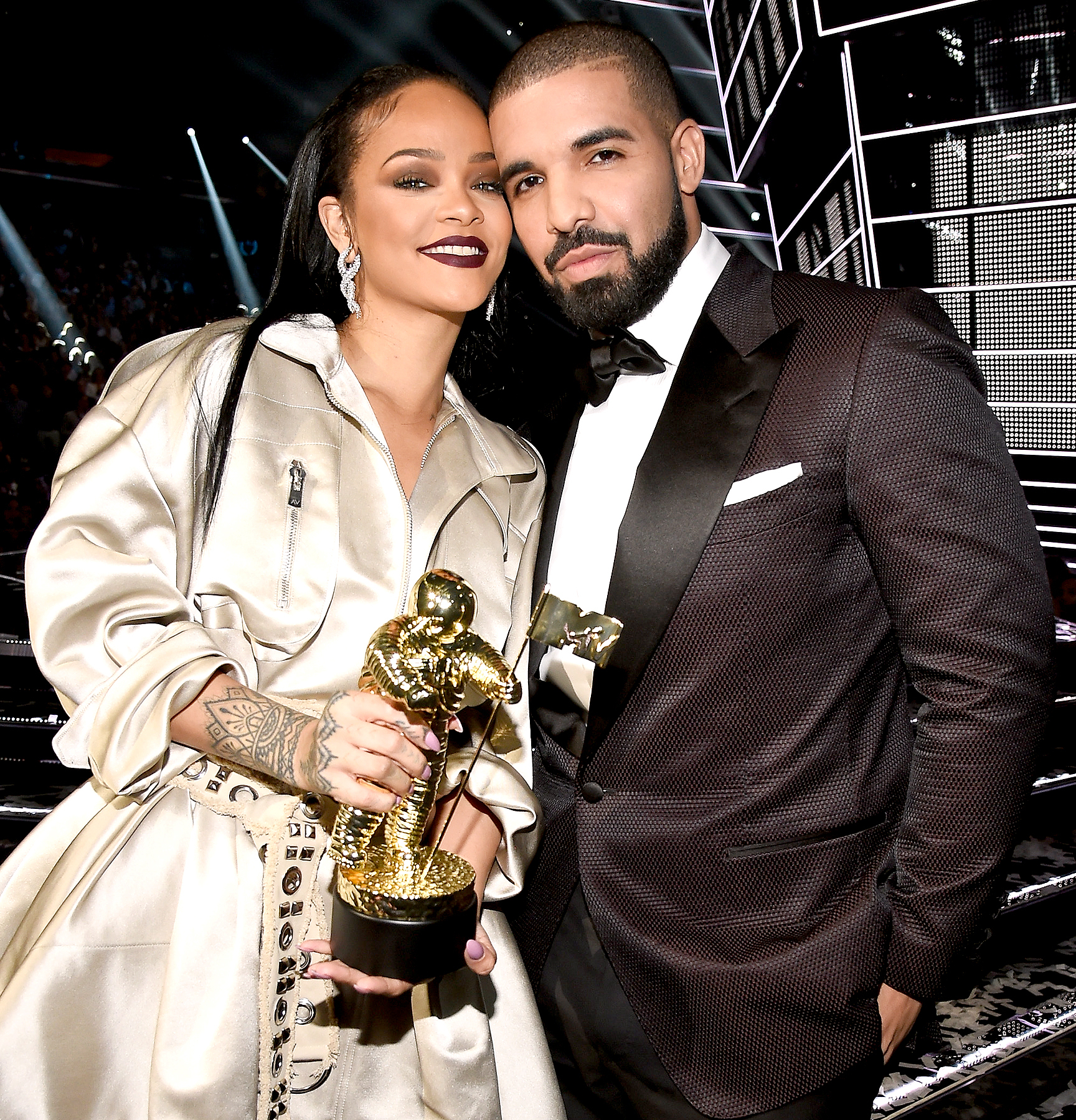 Rihanna and Drake pose onstage during the 2016 MTV Video Music Awards.