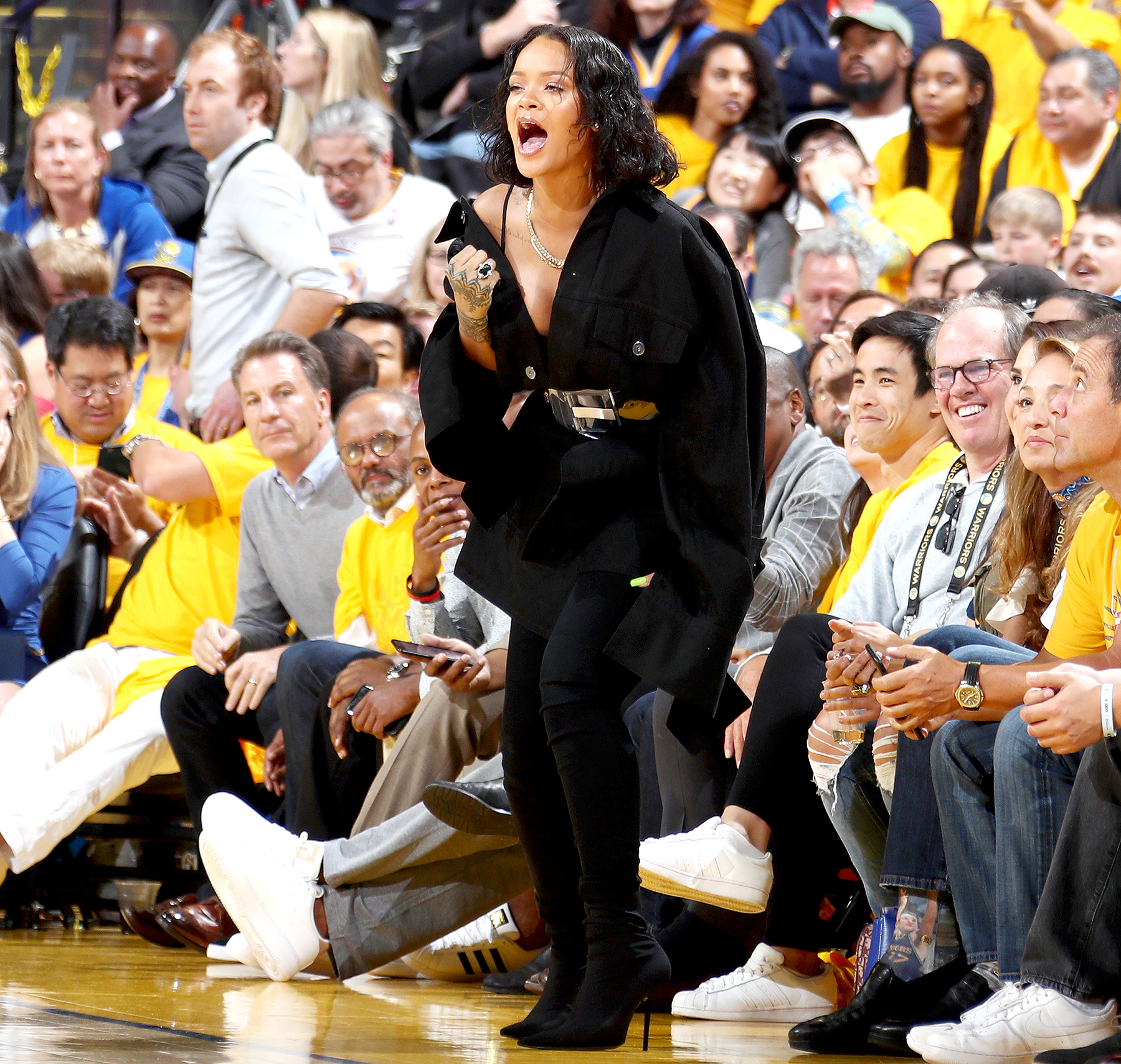 Rihanna cheers from the side line during the game of the Golden State Warriors and the Cleveland Cavaliers in Game One of the 2017 NBA Finals on June 1, 2017 at ORACLE Arena in Oakland, California.
