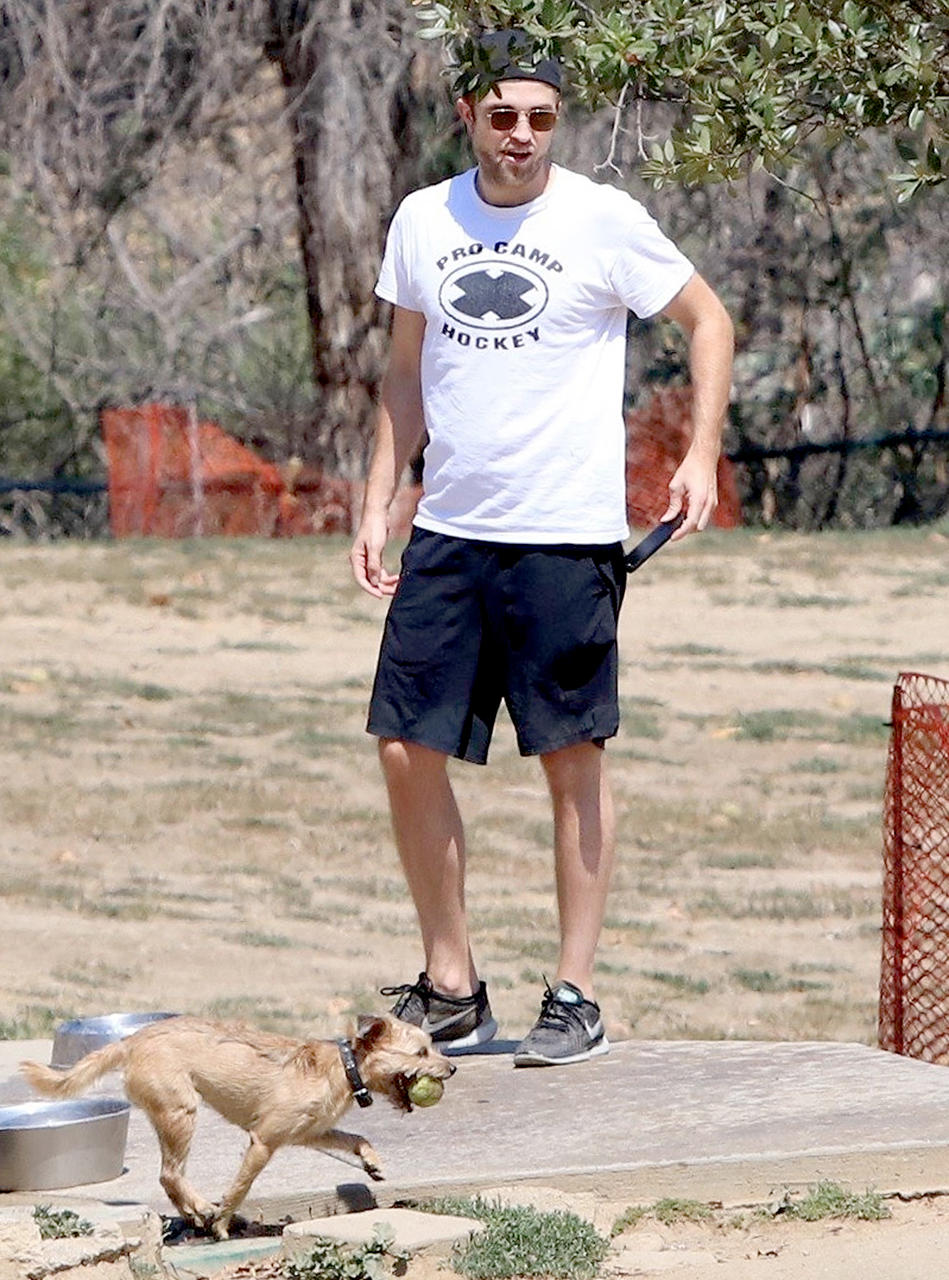 Robert Pattinson enjoys a day at the dog park with his pooch on July 15, 2017.