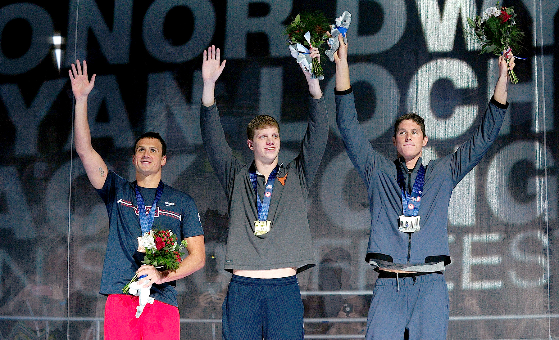 Ryan Lochte, Townley Haas and Conor Dwyer (from left) of the United States participate in the award ceremony for the Men's 200 Meter Freestyle during Day 3 of the 2016 U.S. Olympic Team Swimming Trials at CenturyLink Center on June 28, 2016, in Omaha, NB.