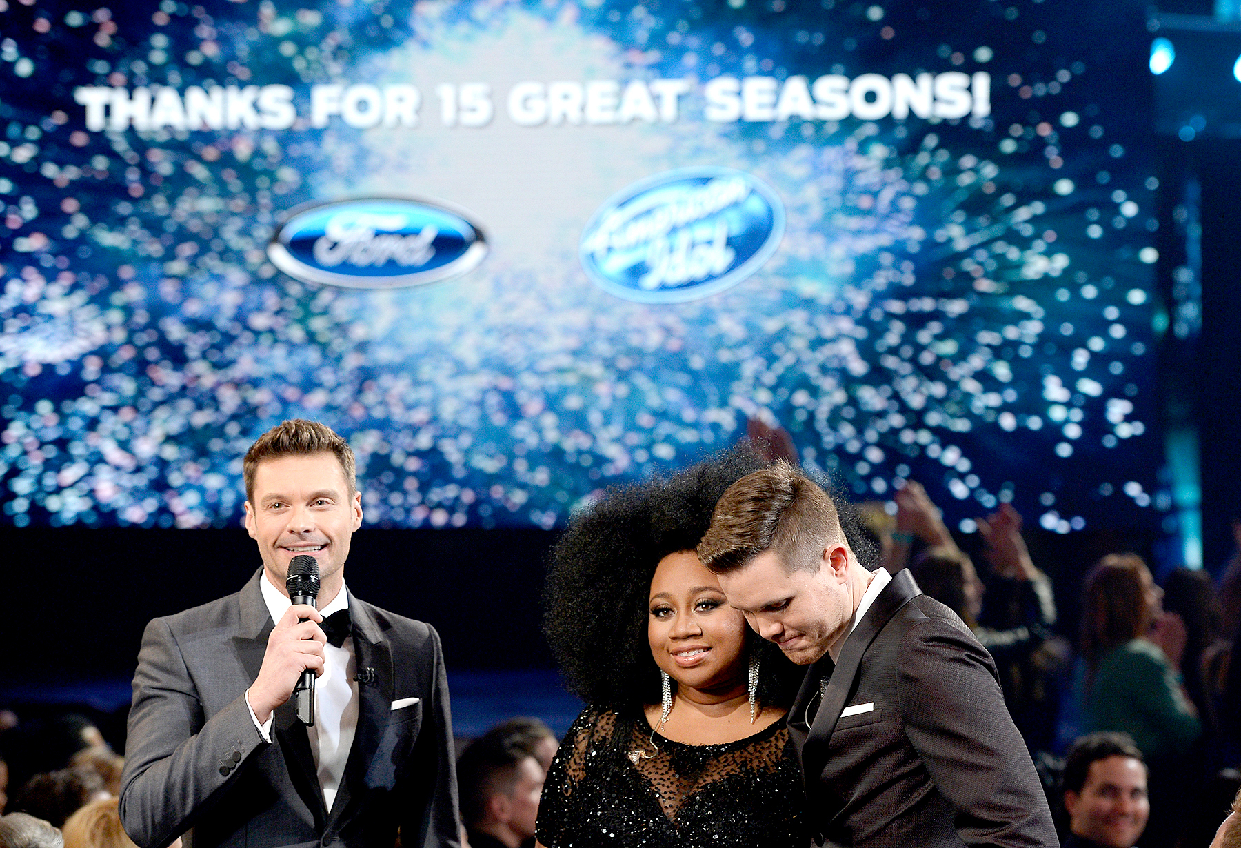 "American Idol Season 15 winner Trent Harmon (R), host Ryan Seacrest (L) and finalist La'Porsha Renae speak onstage during FOX's ""American Idol"" Finale For The Farewell Season at Dolby Theatre on April 7, 2016 in Hollywood, California. at Dolby Theatre on April 7, 2016 in Hollywood, California."