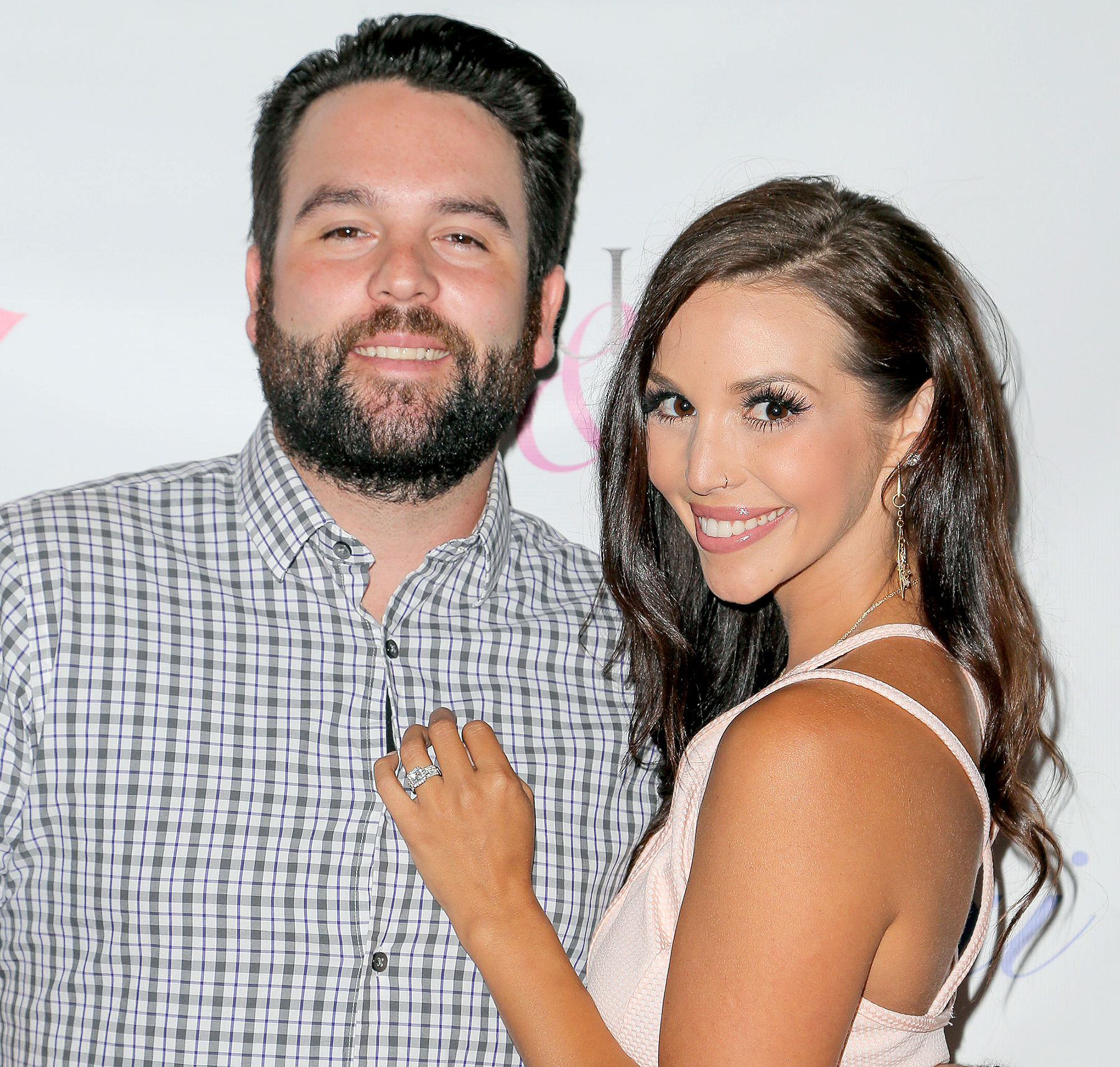 Mike Shay and Scheana Marie attend Katie Maloney's Pucker and Pout launch party at Frederic Fekkai Hair Salon on July 30, 2015 in Beverly Hills, California.