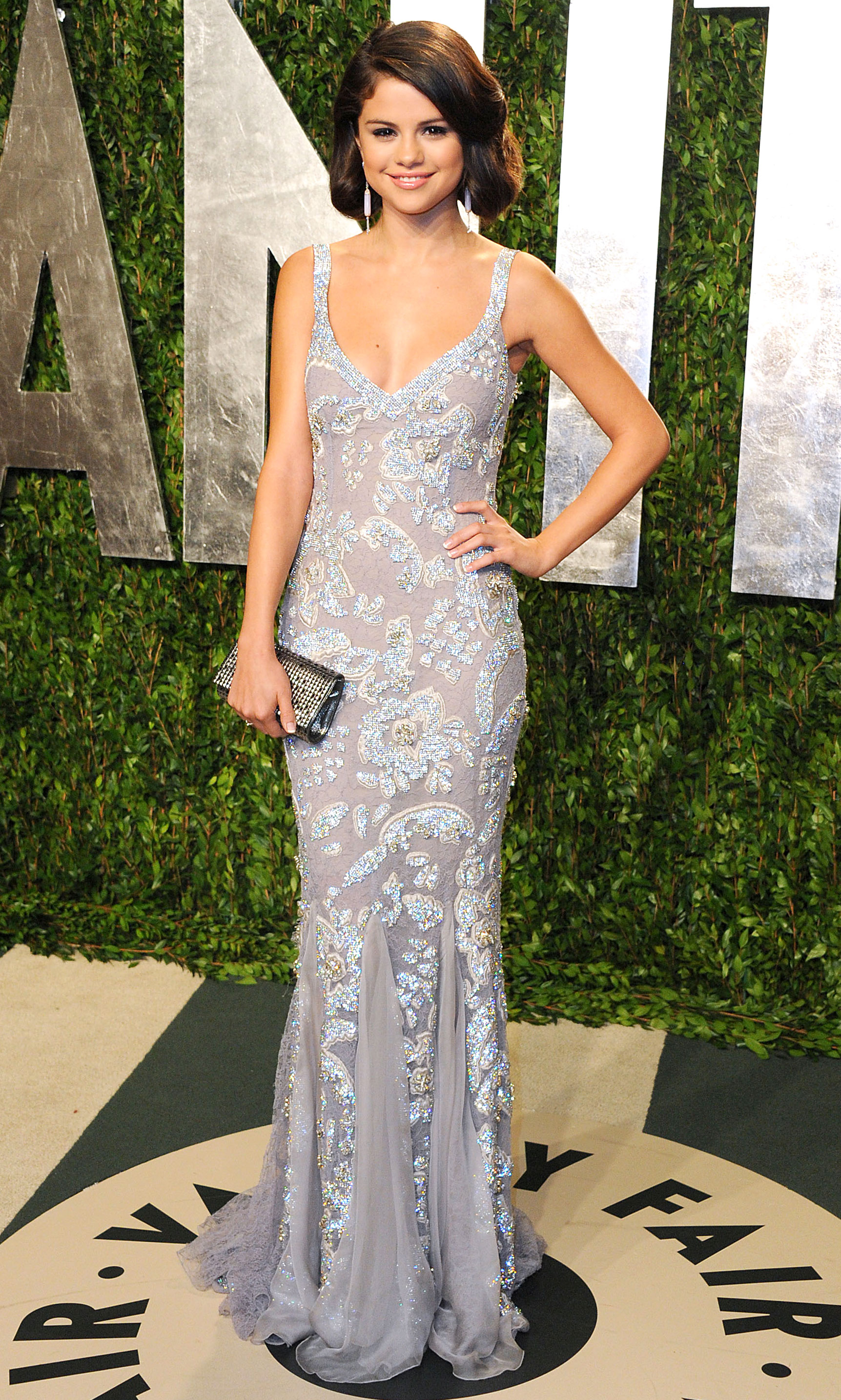 4a60ffdc February 2012. Gomez stunned in a silver Dolce & Gabbana gown with beaded  embellishments at the 2012 Vanity Fair Oscar Party ...