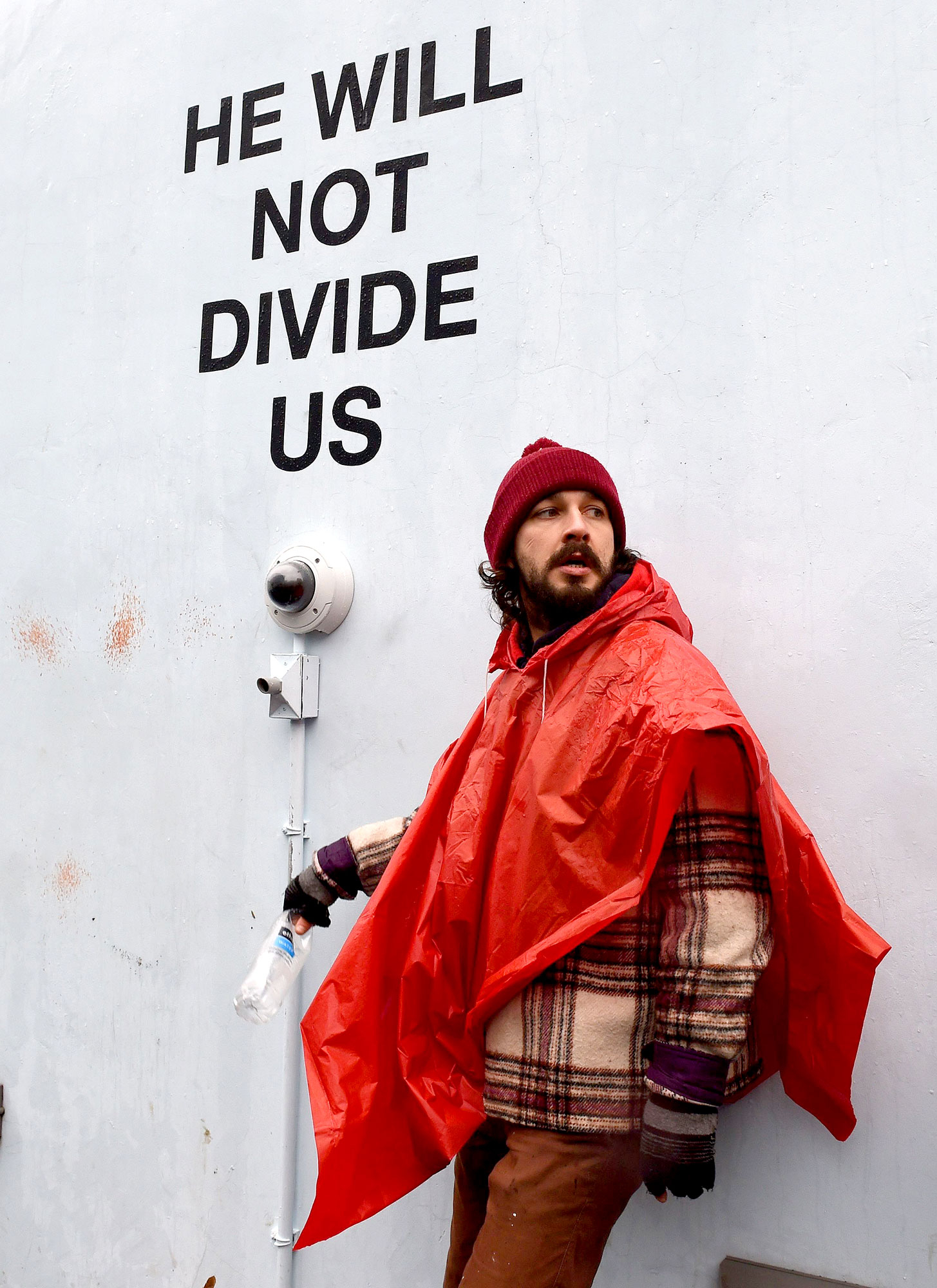 US actor Shia LaBeouf(L)is seen during his He Will Not Divide Us livestream outside the Museum of the Moving Image in Astoria, in the Queens borough of New York January 24, 2017 as a protest against President Donald Trump.