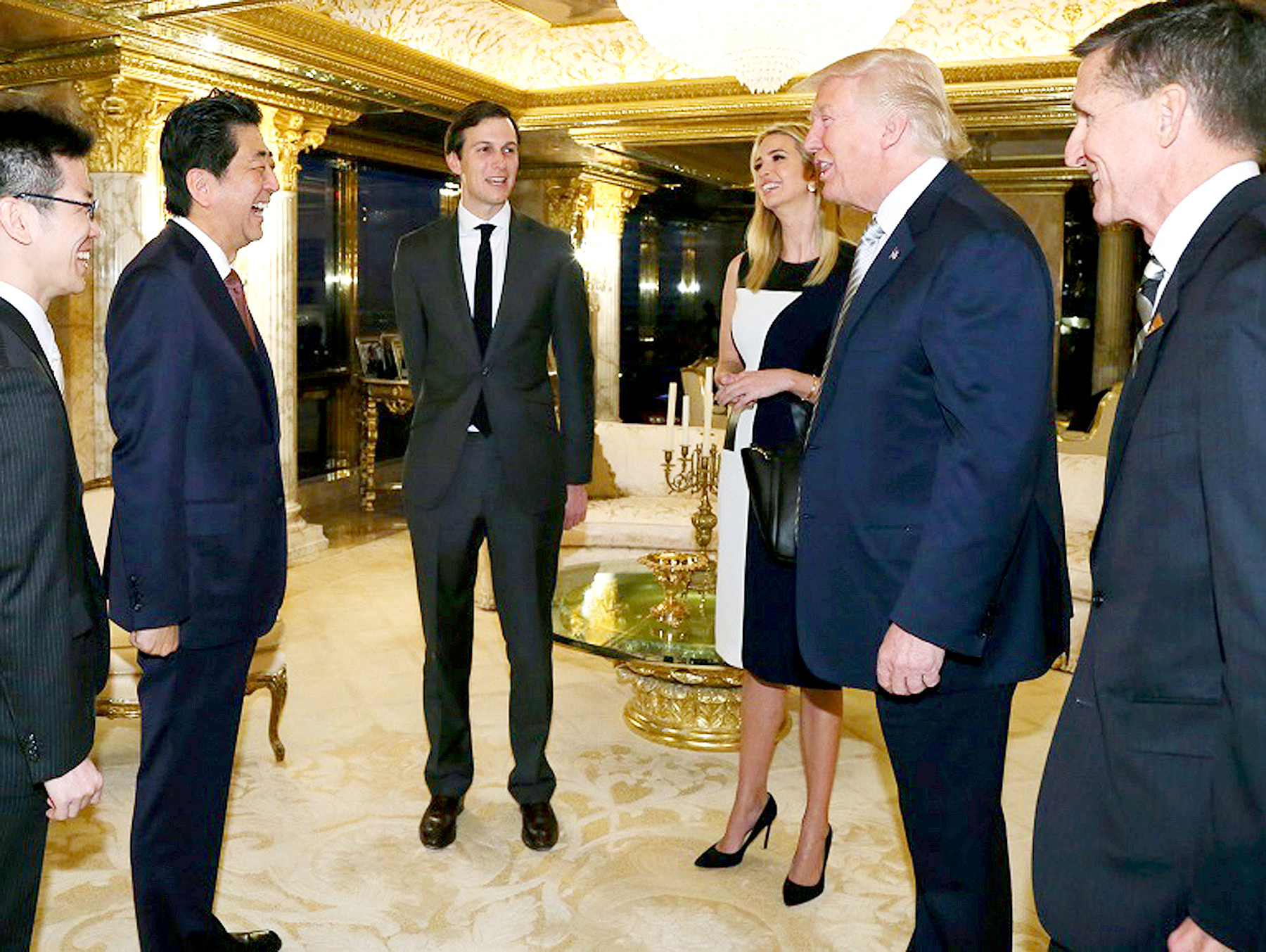 Japanese Prime Minister Shinzo Abe, second from left, chats with U.S. President-elect Donald Trump, second from right, during a meeting as Ivanka Trump, third from right, the oldest daughter of Donald Trump, and her husband, Jared Kushner.