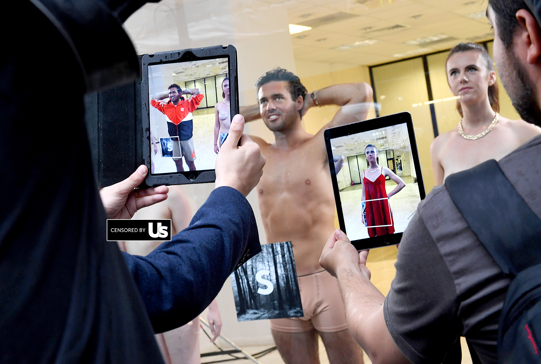 Spencer Matthews poses in a shop window to launch Lyst's augmented reality dressing experience on September 16, 2016 in London, England.