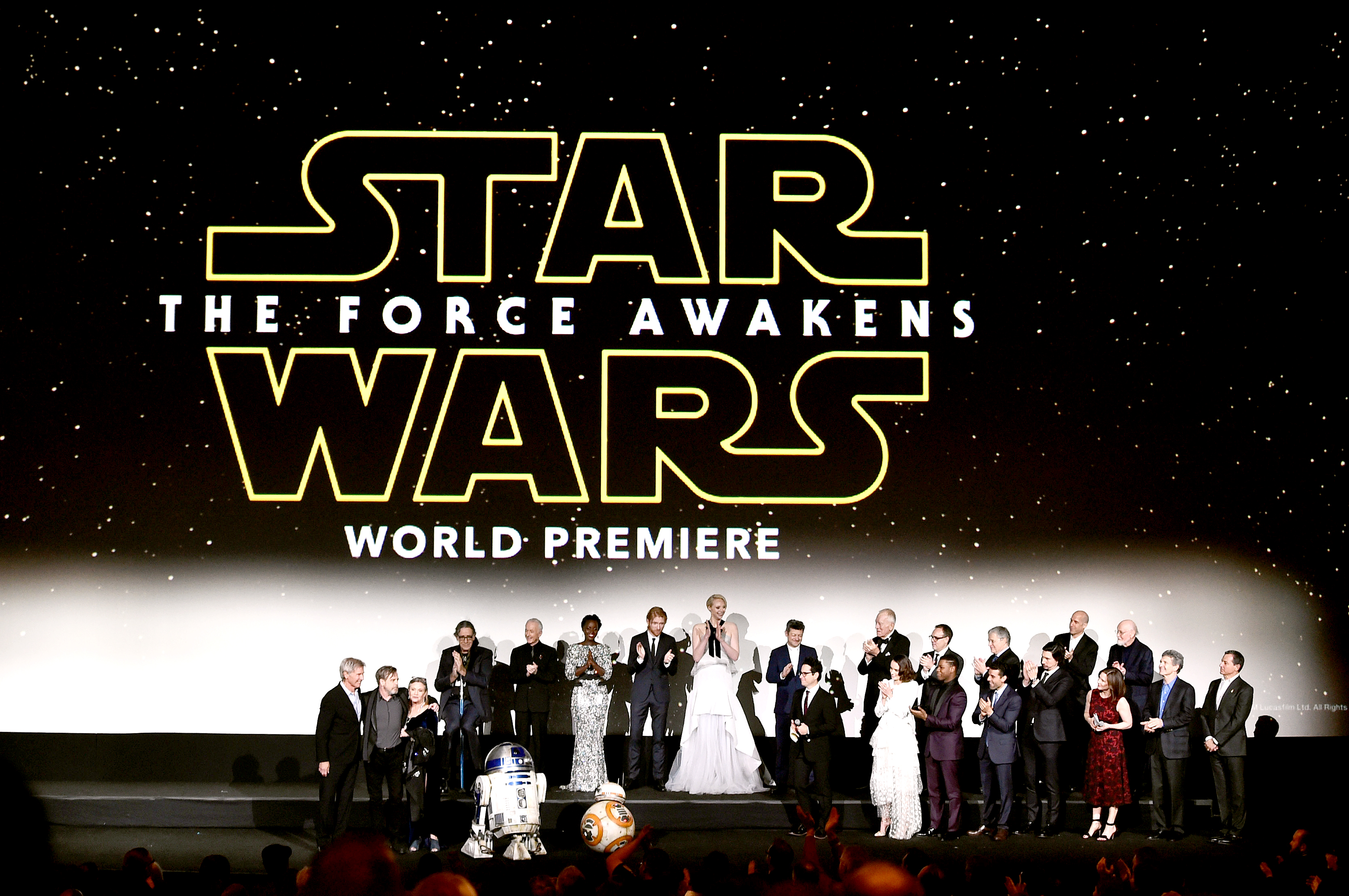 The cast and crew speak onstage during the World Premiere of Star Wars: The Force Awakens.