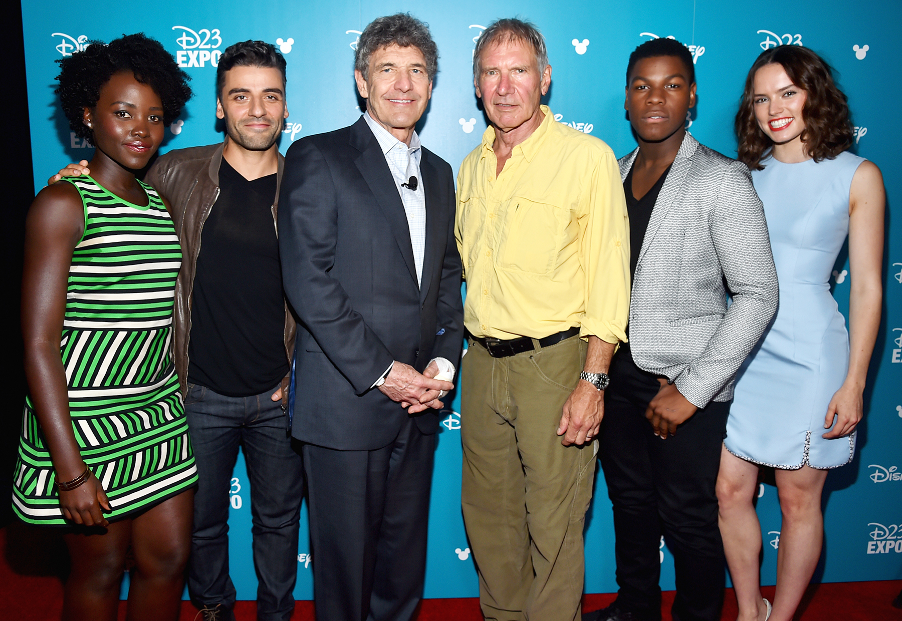 Lupita Nyong'o, Oscar Isaac, Harrison Ford, John Boyega and Daisy Ridley posed with Walt Disney Studios Chairman Alan Horn at an August 2015 event.