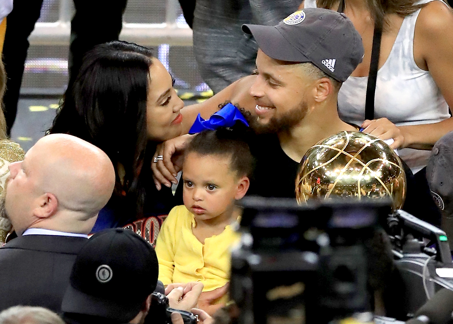 Stephen Curry #30 of the Golden State Warriors celebrates with his wife Ayesha after defeating the Cleveland Cavaliers 129-120 in Game 5 to win the 2017 NBA Finals at ORACLE Arena on June 12, 2017 in Oakland, California.