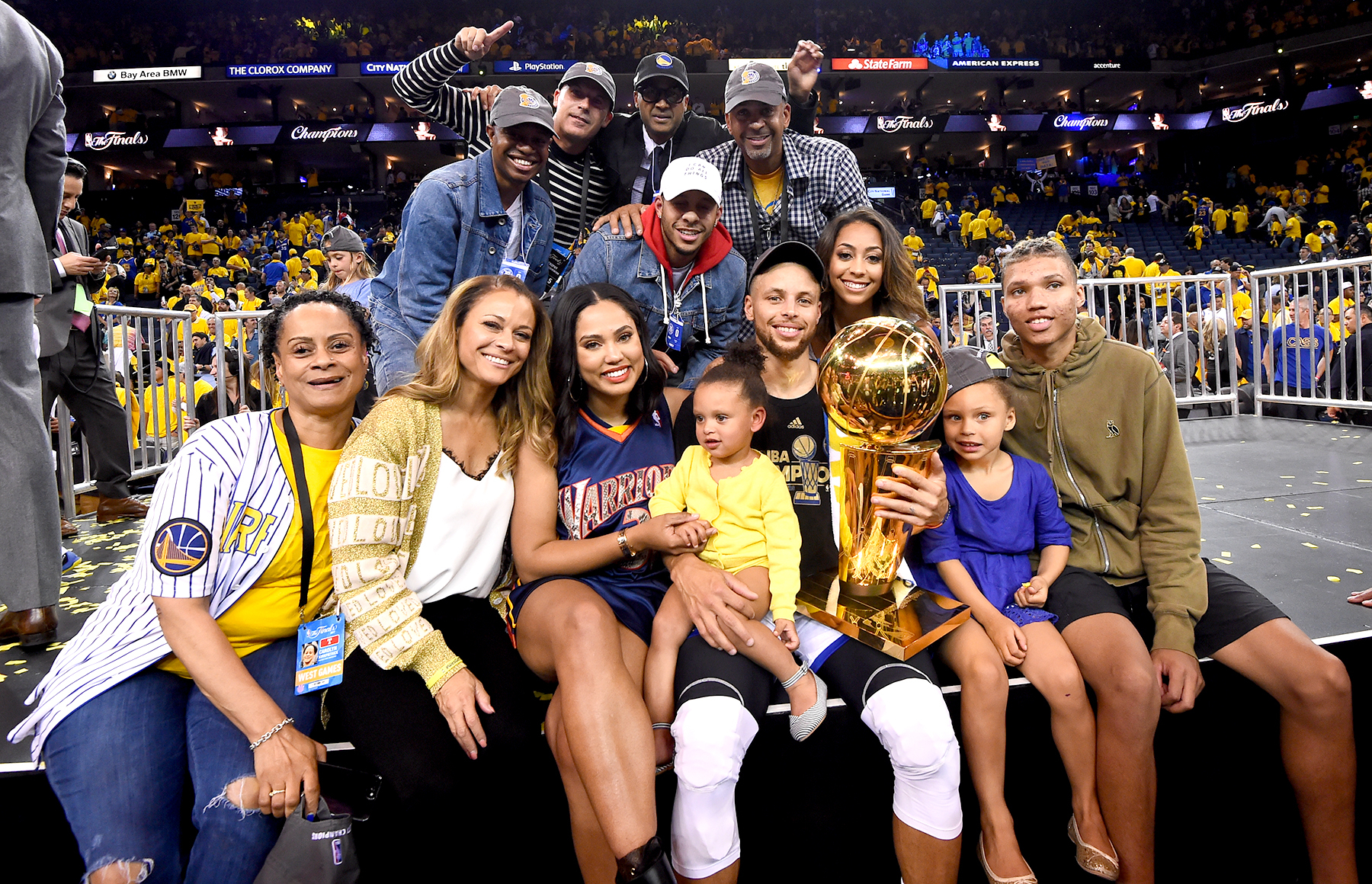 Stephen Curry #30 of the Golden State Warriors with family and friends celebrates winning the NBA Championship in Game Five against the Cleveland Cavaliers of the 2017 NBA Finals on June 12, 2017 at Oracle Arena in Oakland, California.