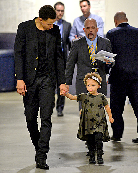 Riley and Stephen Curry (walking)