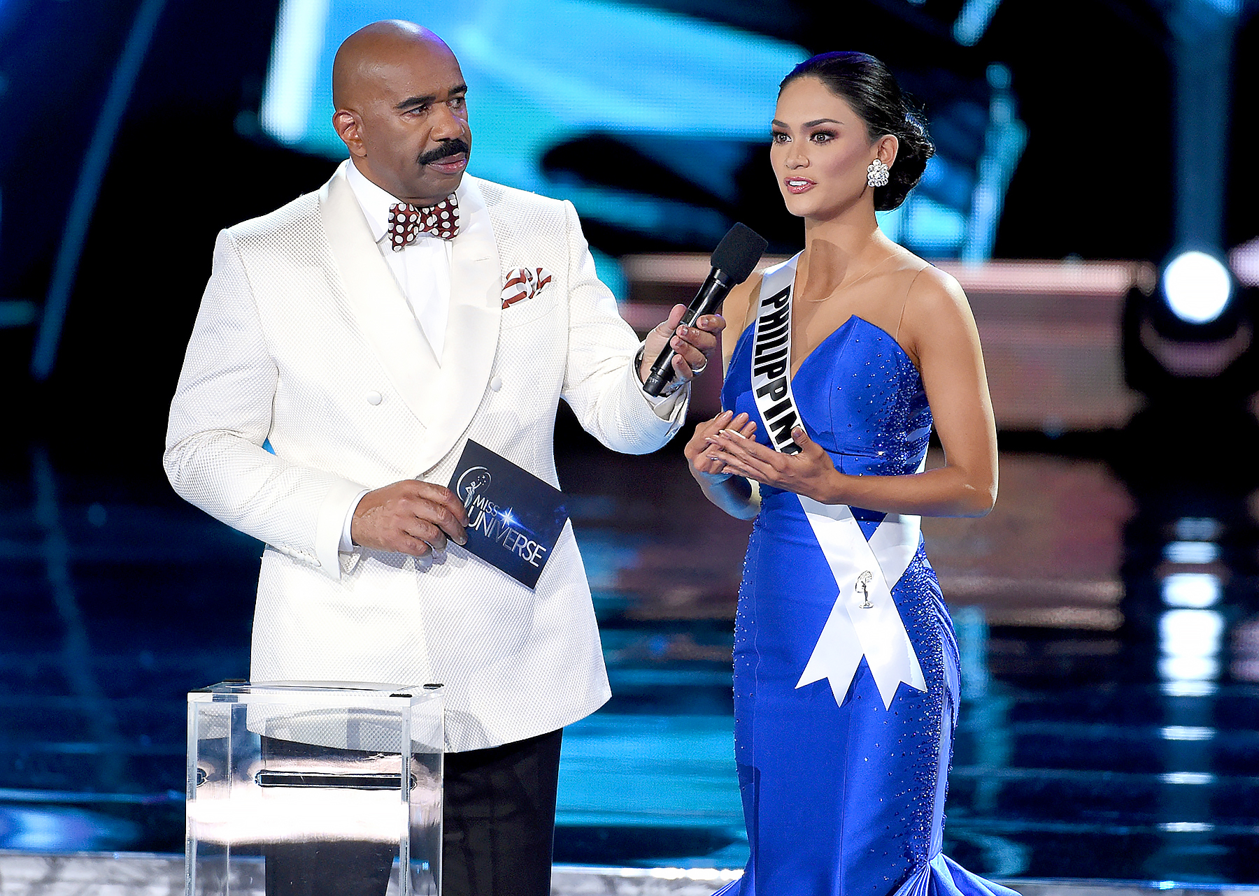 Host Steve Harvey listens as Miss Philippines 2015, Pia Alonzo Wurtzbach, answers a question during the interview portion of the 2015 Miss Universe Pageant at The Axis at Planet Hollywood Resort & Casino on December 20, 2015 in Las Vegas, Nevada.