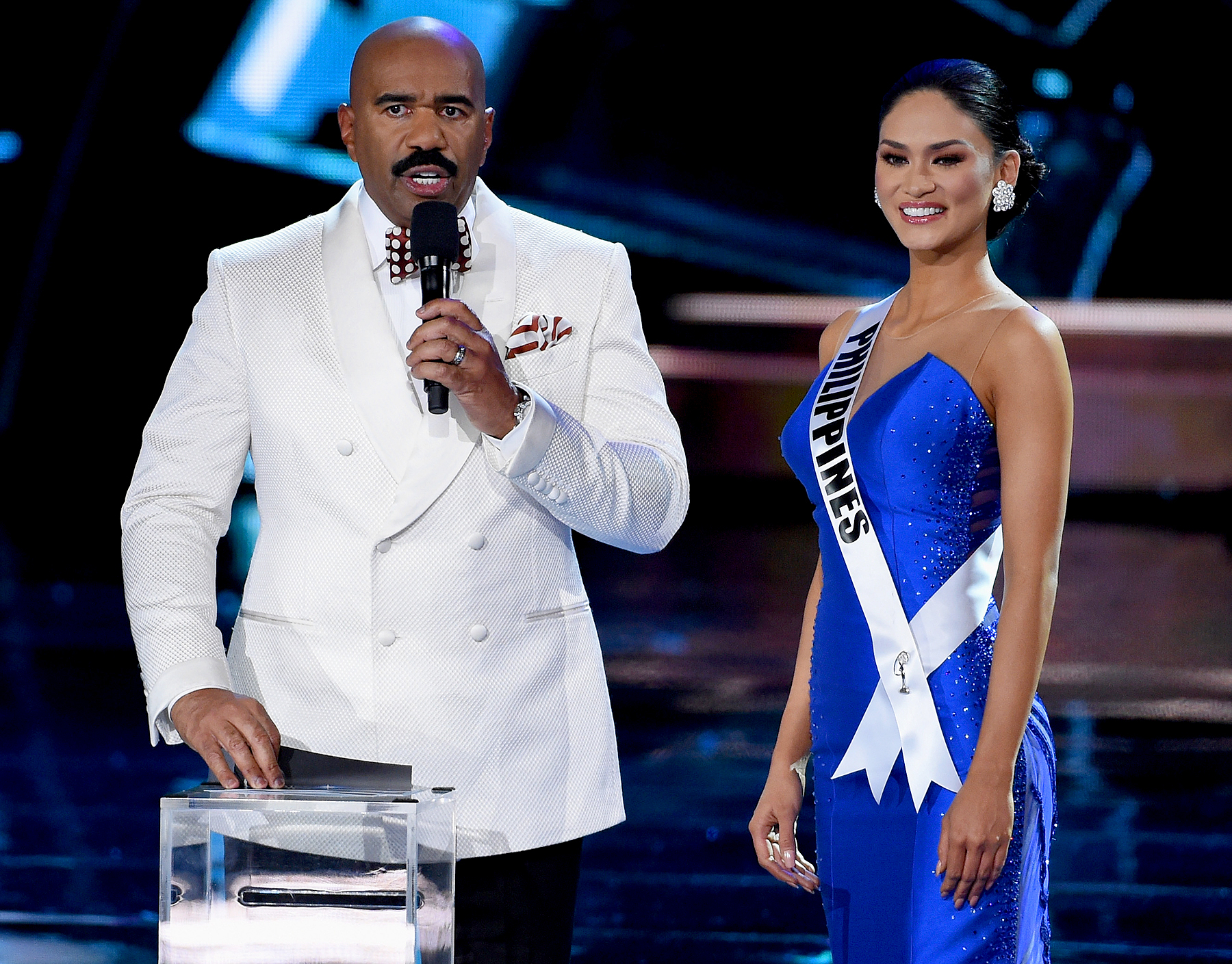 Host Steve Harvey (L) asks Miss Philippines 2015, Pia Alonzo Wurtzbach, a question during the interview portion of the 2015 Miss Universe Pageant at The Axis at Planet Hollywood Resort & Casino on December 20, 2015 in Las Vegas, Nevada.