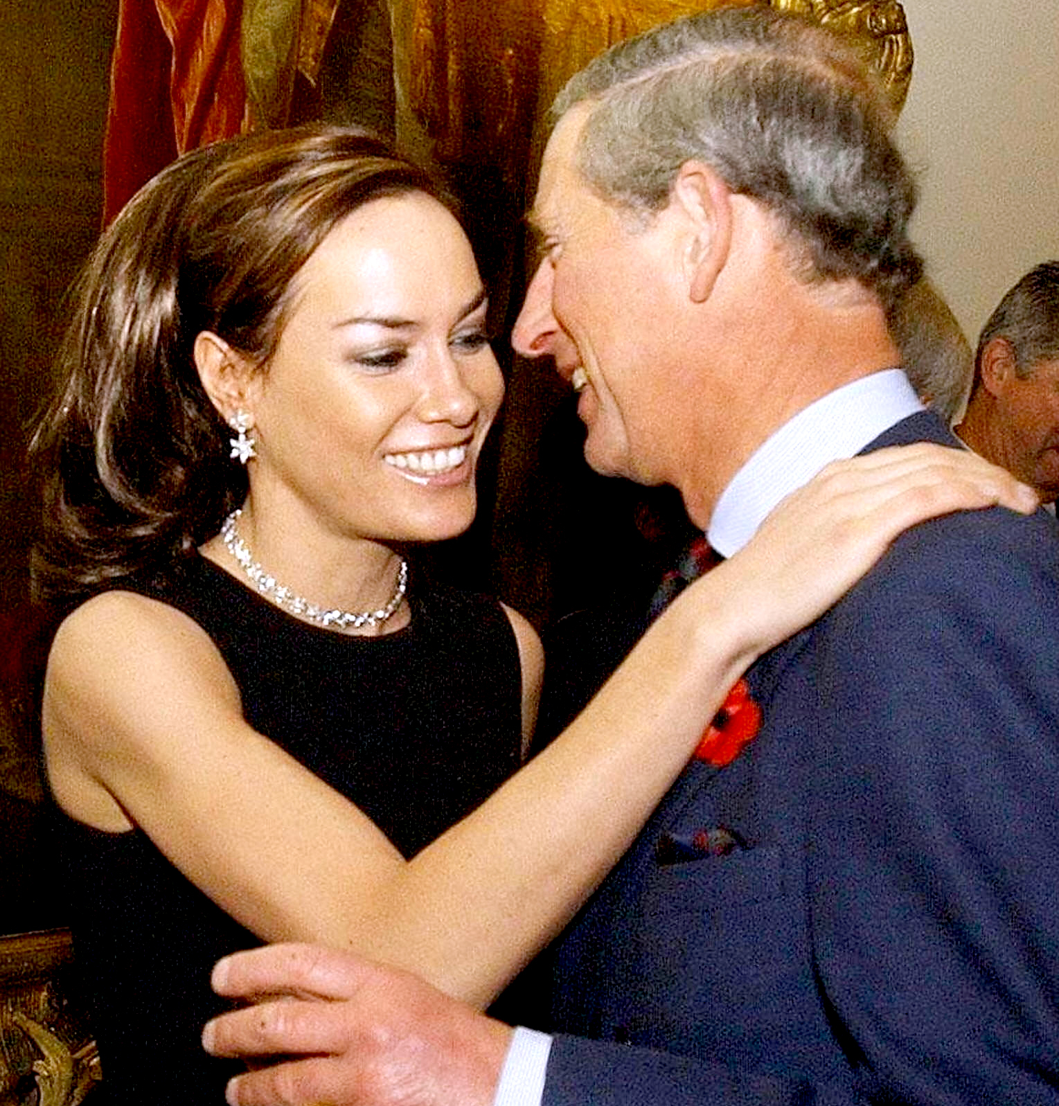 The Prince of Wales is geeted by Tara Palmer-Tomkinson during a reception at Clarence House, London, 27 October, 2003.