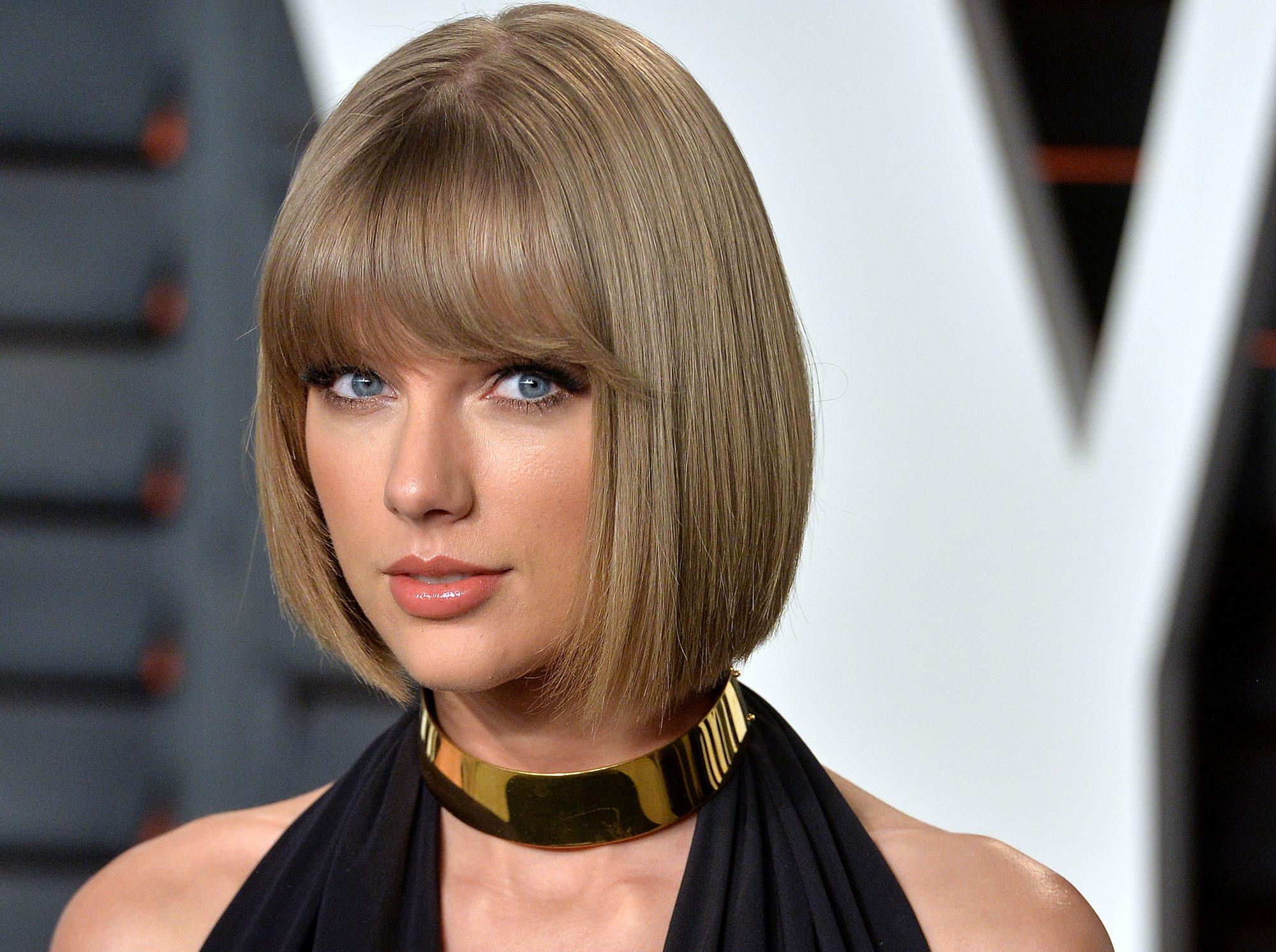 Eddie Redmayne has denied dating Taylor Swift