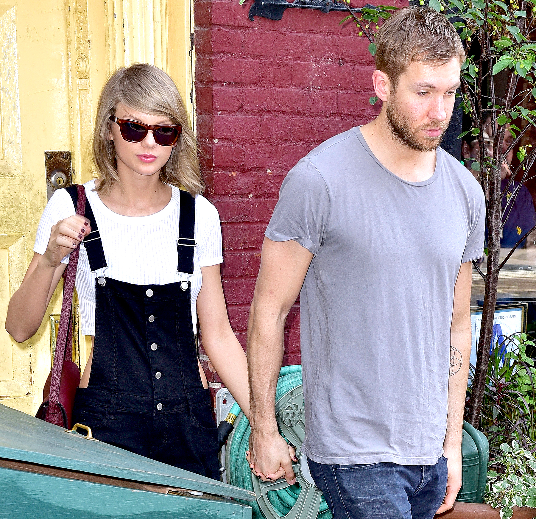 Taylor Swift and Calvin Harris leave the Spotted Pig restaurant on May 28, 2015, in New York City.