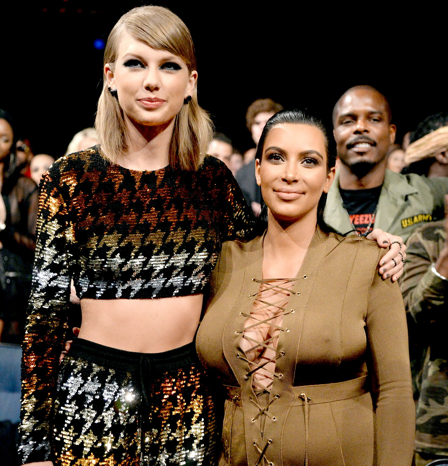 Taylor Swift and Kim Kardashian West attend the 2015 MTV Video Music Awards.