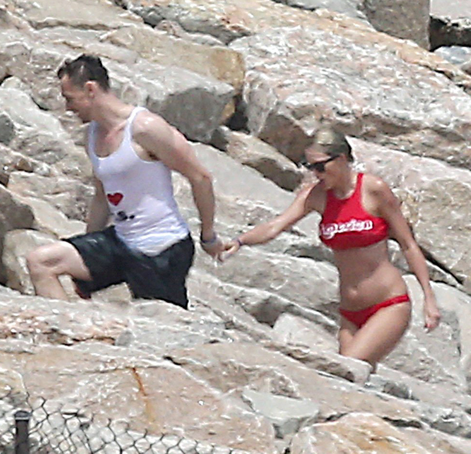 Taylor Swift Kisses Tom Hiddleston During July 4th Party