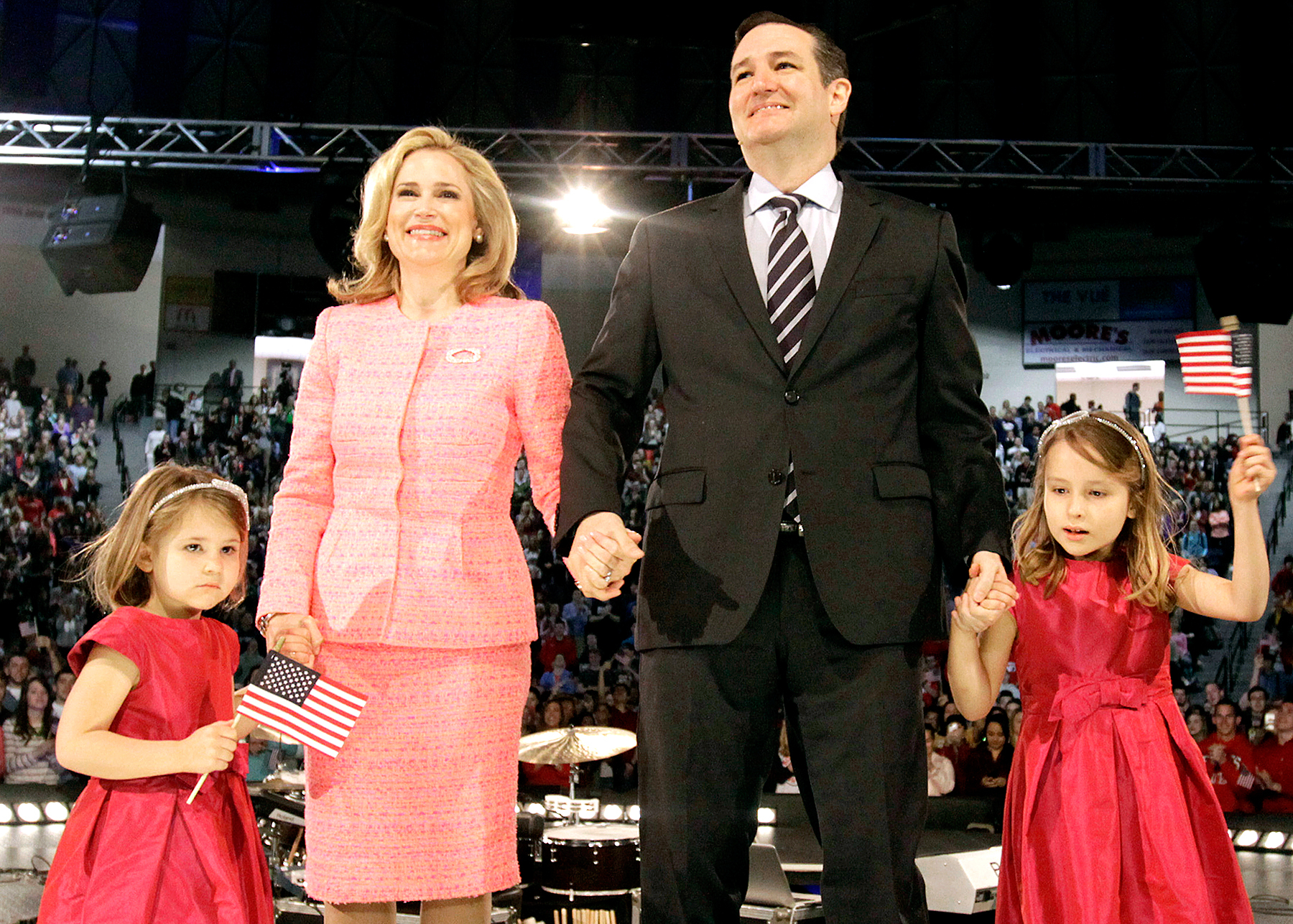U.S. Senator Ted Cruz, a Republican from Texas, stands with his wife Heidi Nelson Cruz and daughters Catherine Cruz, left, and Caroline Cruz, right, as he marks the start of his presidential campaign by giving the convocation address at Liberty University in Lynchburg, Virginia, on March 23, 2015.