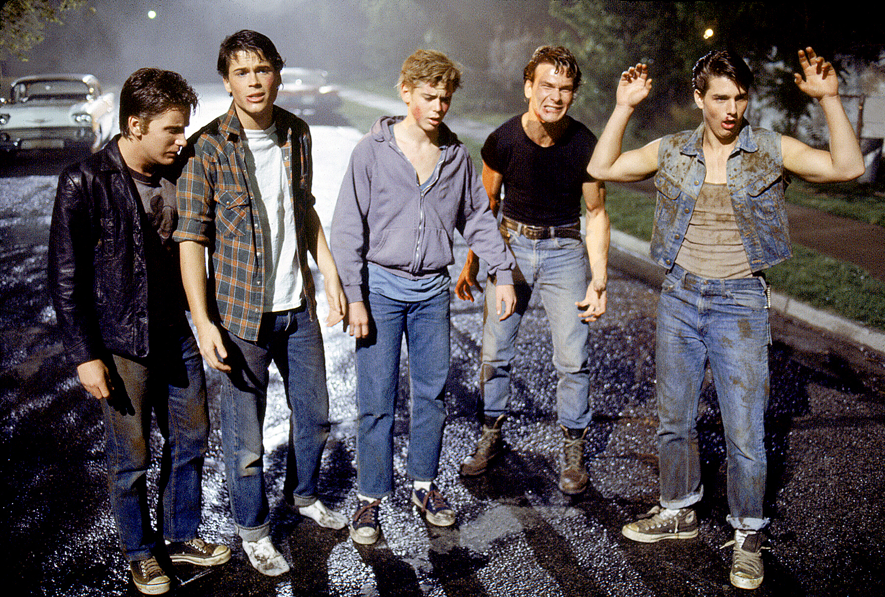 Emilio Estevez, Rob Lowe, Thomas C. Howell, Patrick Swayze, and Tom Cruise on the set of The Outsiders.