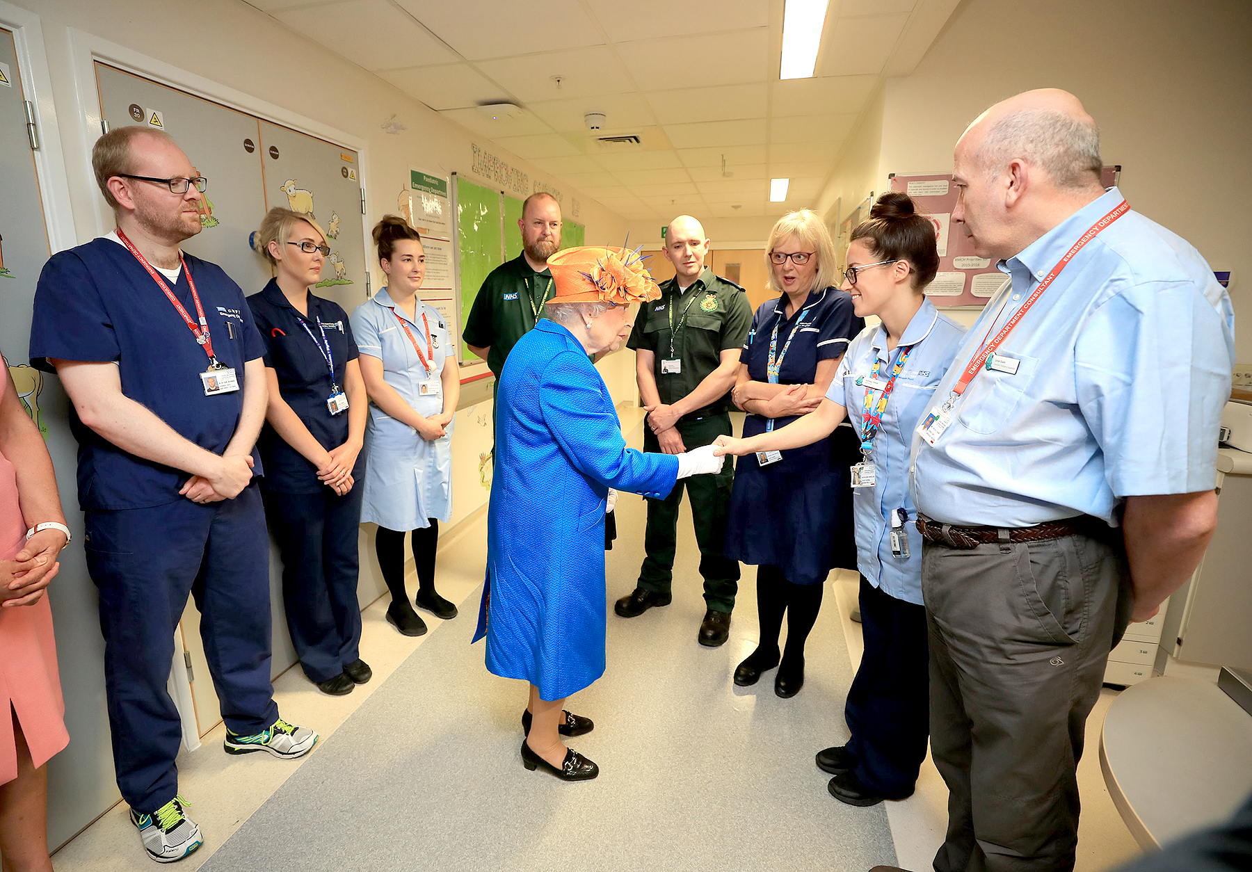 Queen Elizabeth II shakes hands with a nurse during a visit to the Royal Manchester Children's Hospital on May 25, 2017 in Manchester, England.