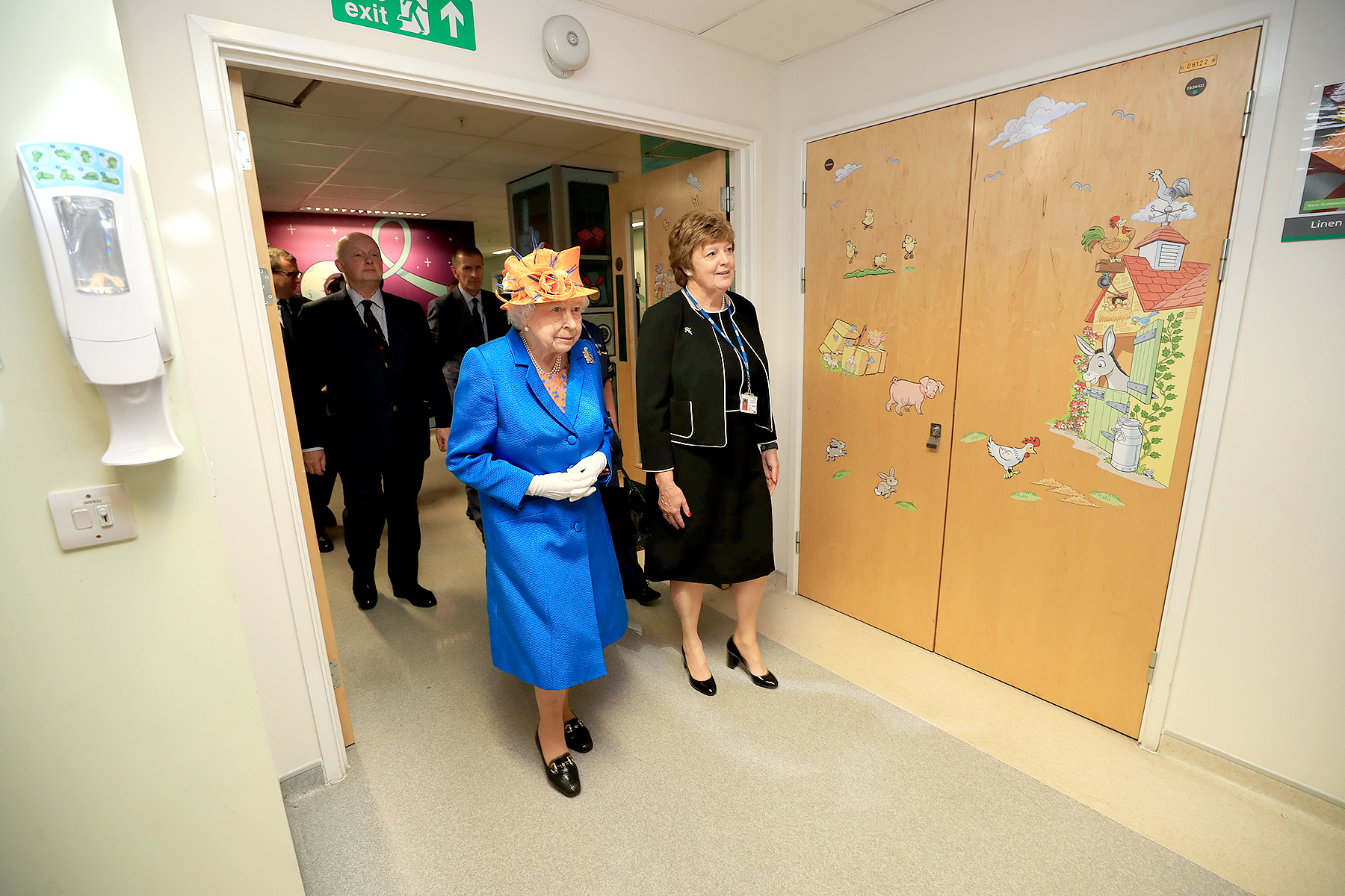 Queen Elizabeth II escorted by Kathy Cowell (R) Chairman of the Central Manchester University Hospital, during a visit to the Royal Manchester Children's Hospital on May 25, 2017 in Manchester, England.