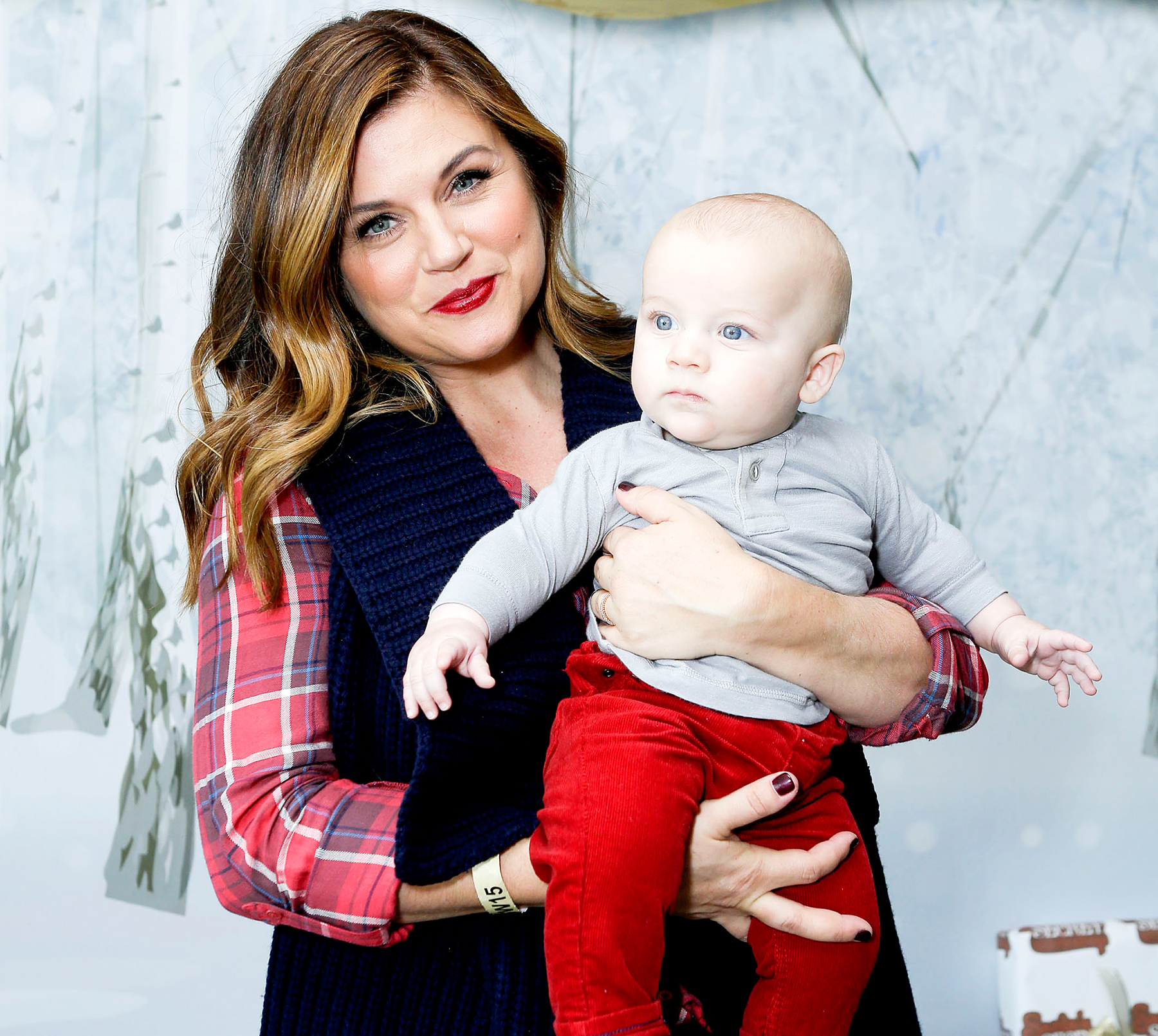 Tiffani Thiessen and son Holt Smith attend 2015 Santa's Secret Workshop Benefiting L.A. Family Housing at Andaz Hotel on December 5, 2015 in Los Angeles.