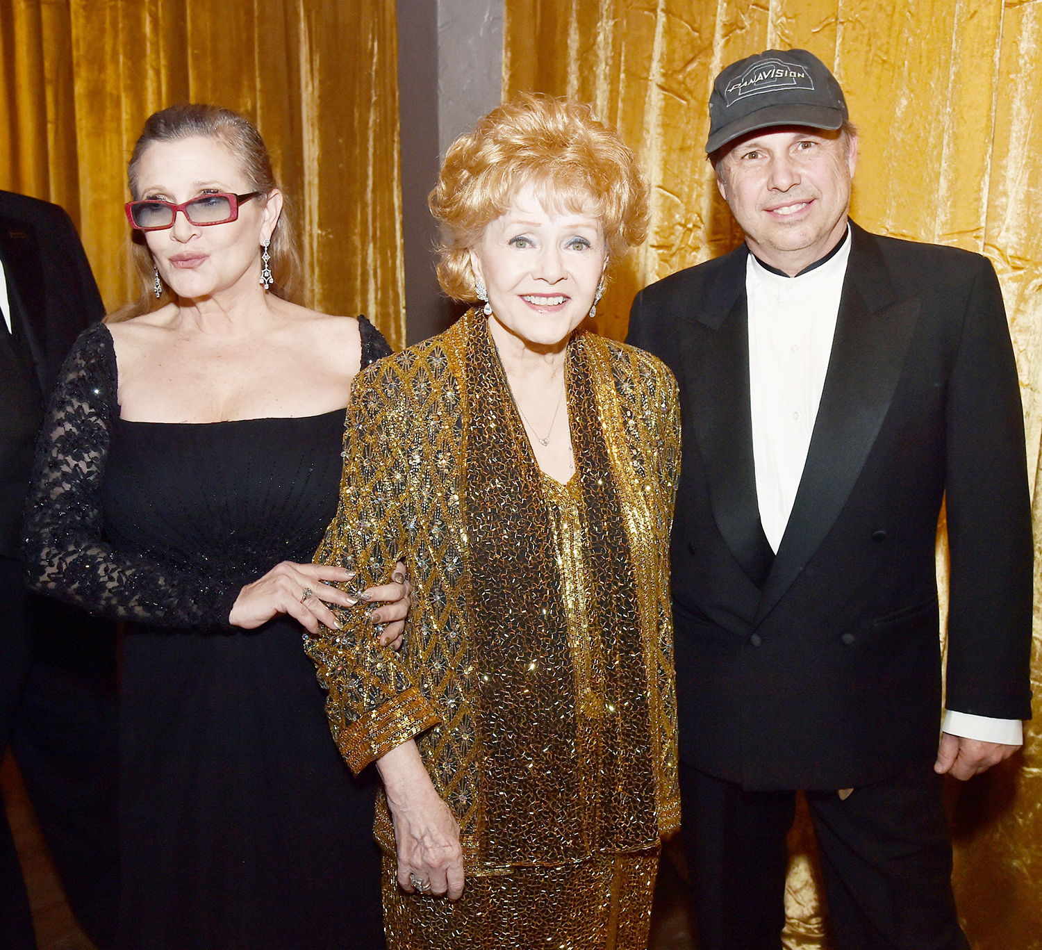 Carrie Fisher, Debbie Reynolds and Todd Fisher at TNT's 21st Annual Screen Actors Guild Awards on Jan. 25, 2015, in Los Angeles.
