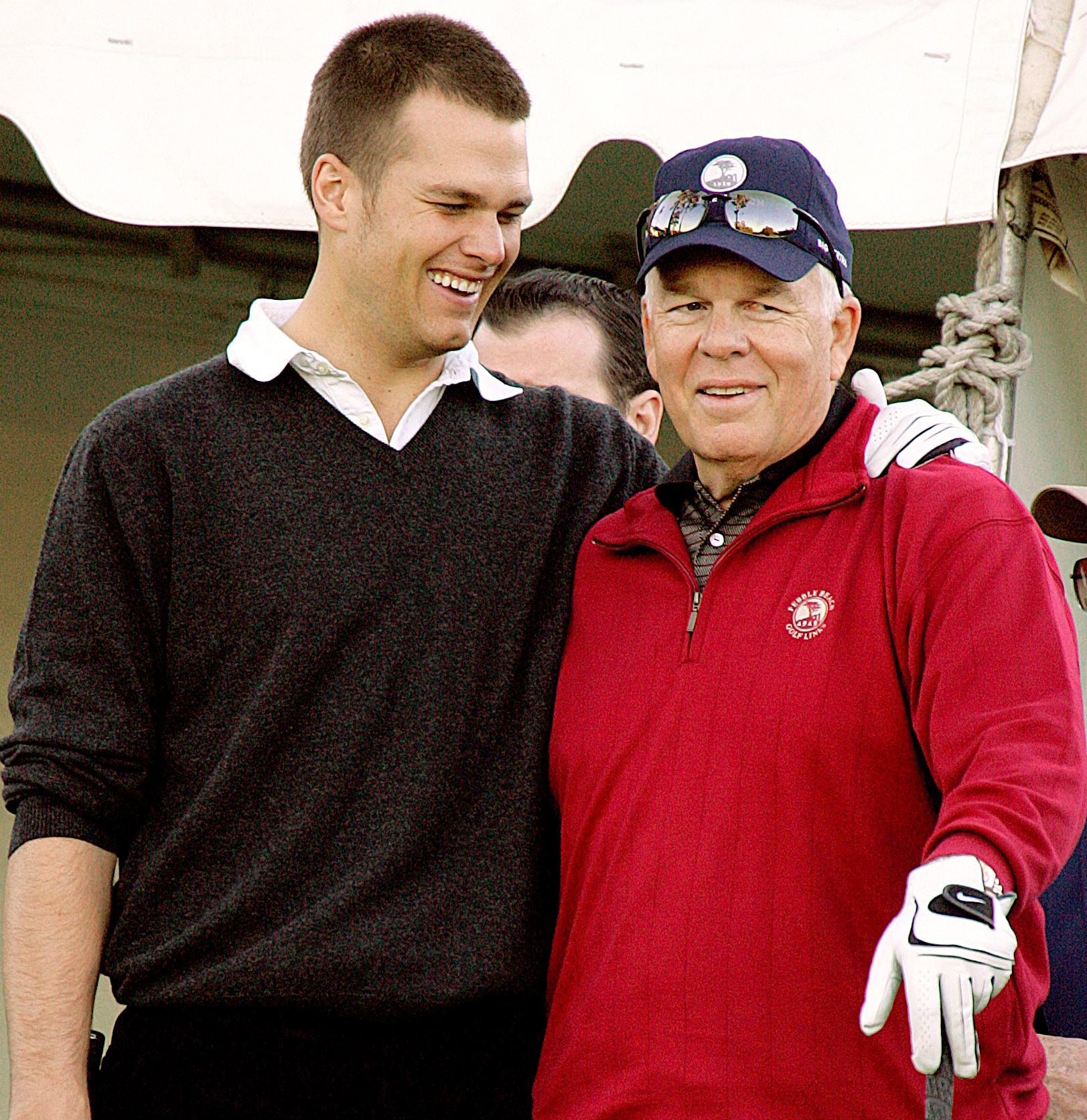 Tom Brady, left, hugs his father Tom Brady Sr. on the first hole of the Poppy Hills course during the first round of the AT&T Pebble Beach National Pro-Am golf tournament Thursday, Feb. 9, 2006, in Pebble Beach, Calif.